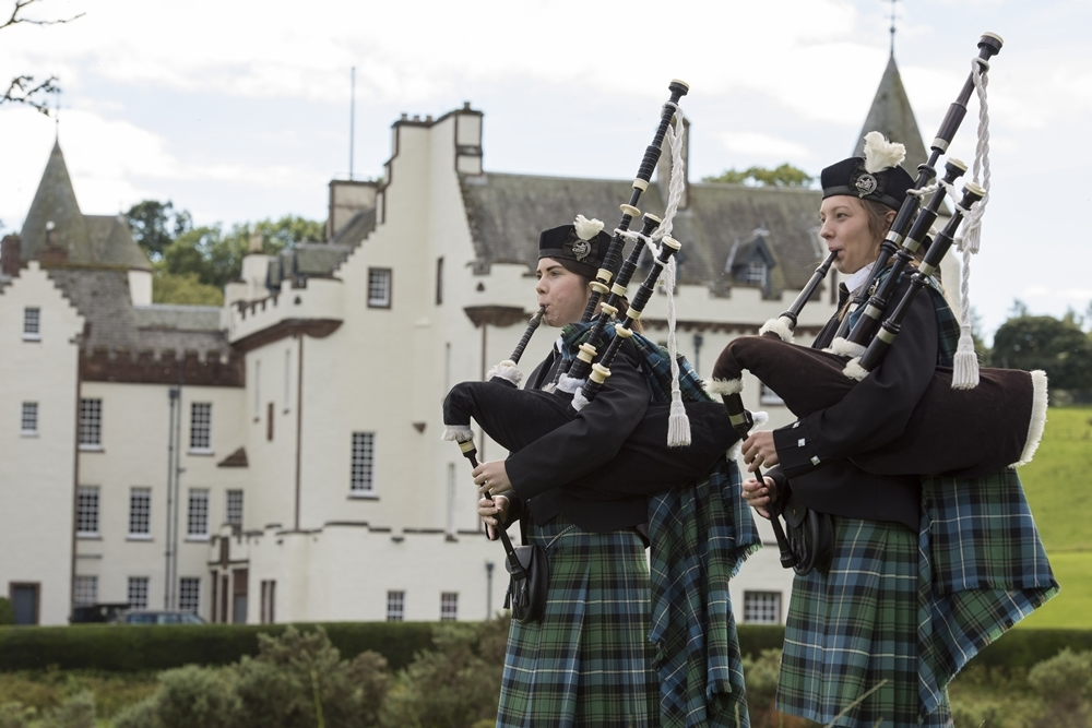 Forfar and District Pipers Elaina Stewart and Heather Robertson are pictured in front of Cortachy Castle.