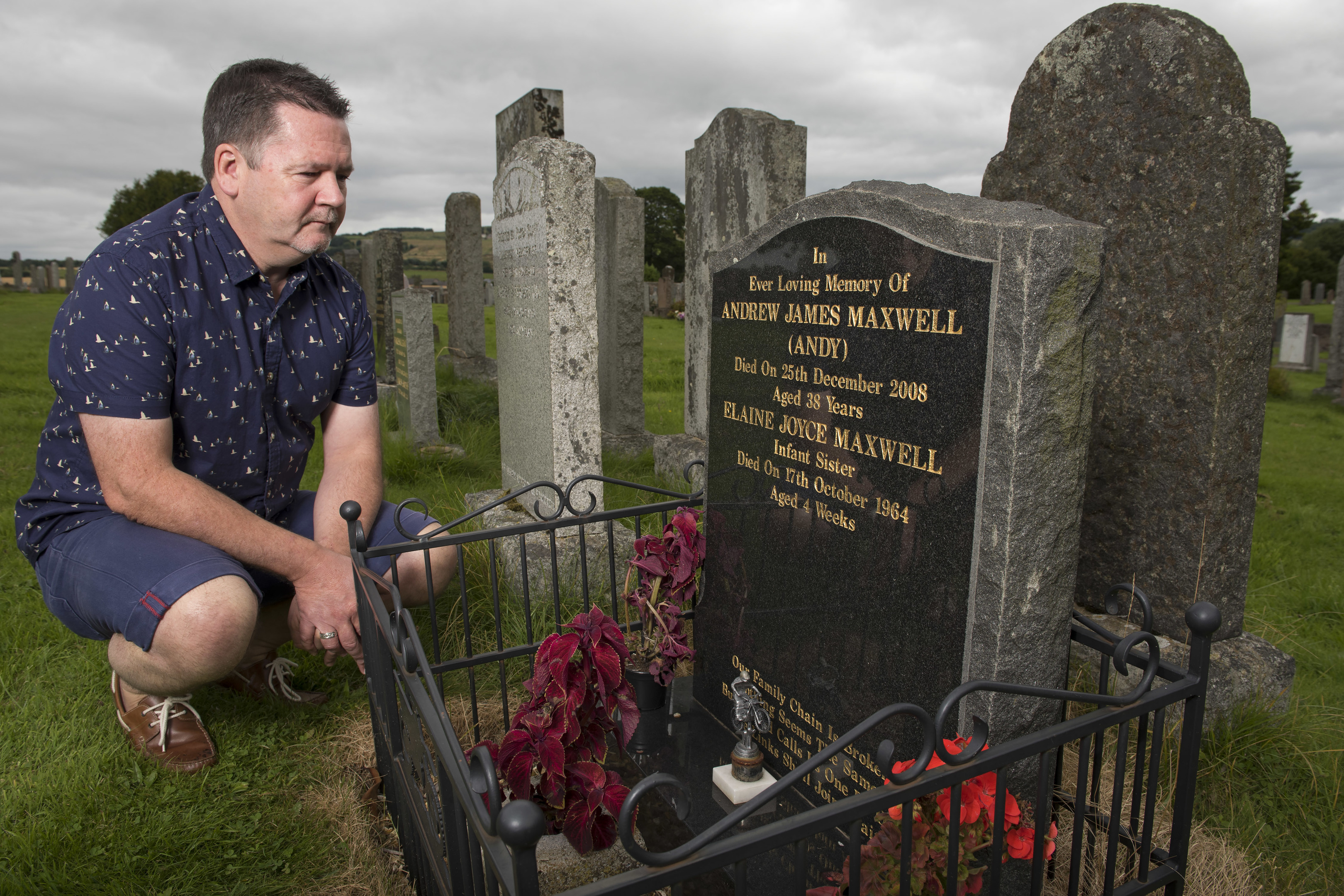 Roddy Maxwell at the grave of his brother Andy.