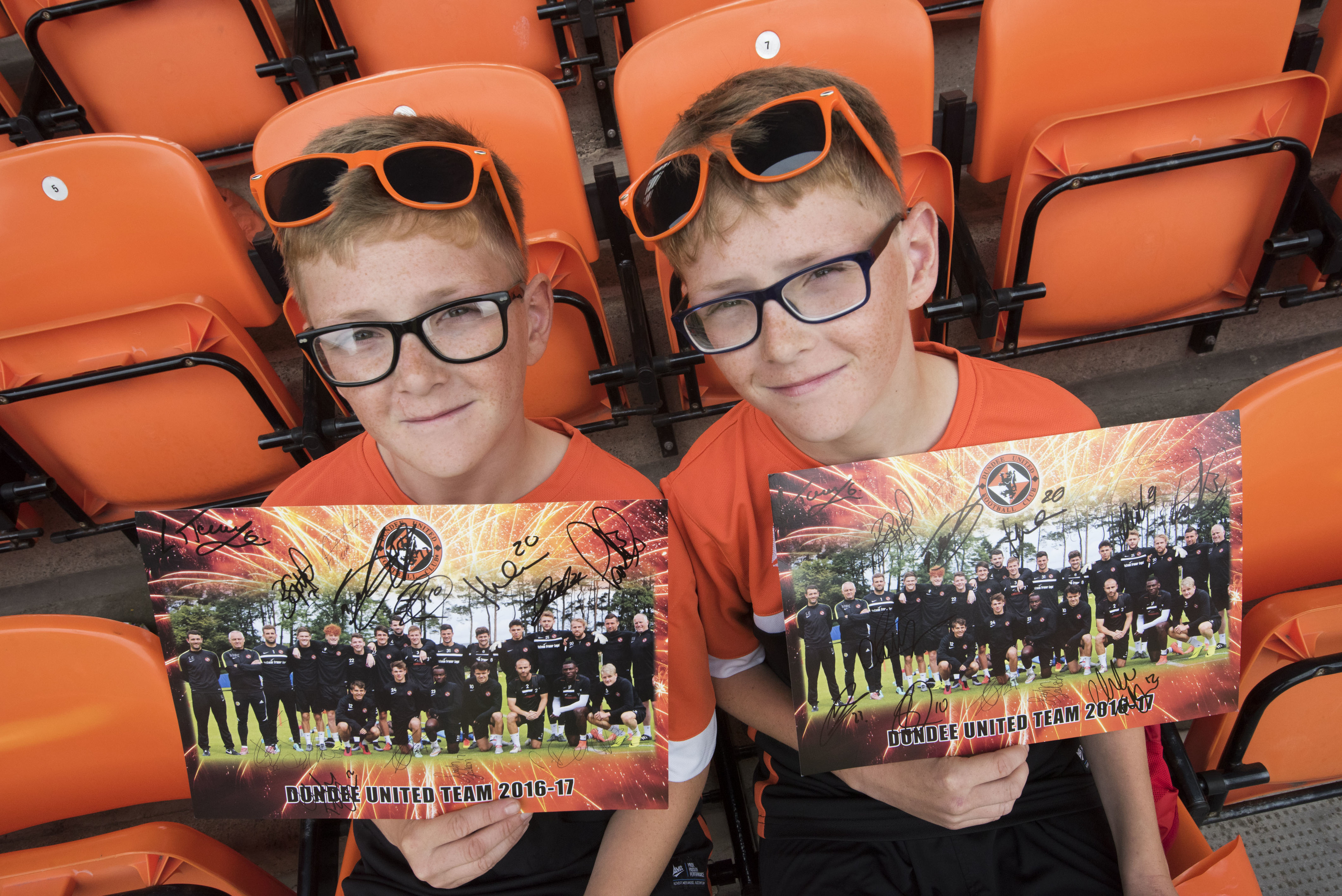 Twins Luis and Marshall Sirling (13) with their signed posters