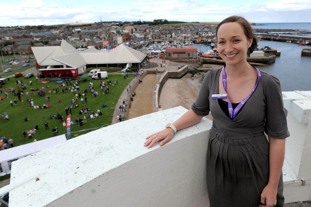 Claire Wallace of the Signal Tower Museum looks out on the Beacon Green during the festivities.