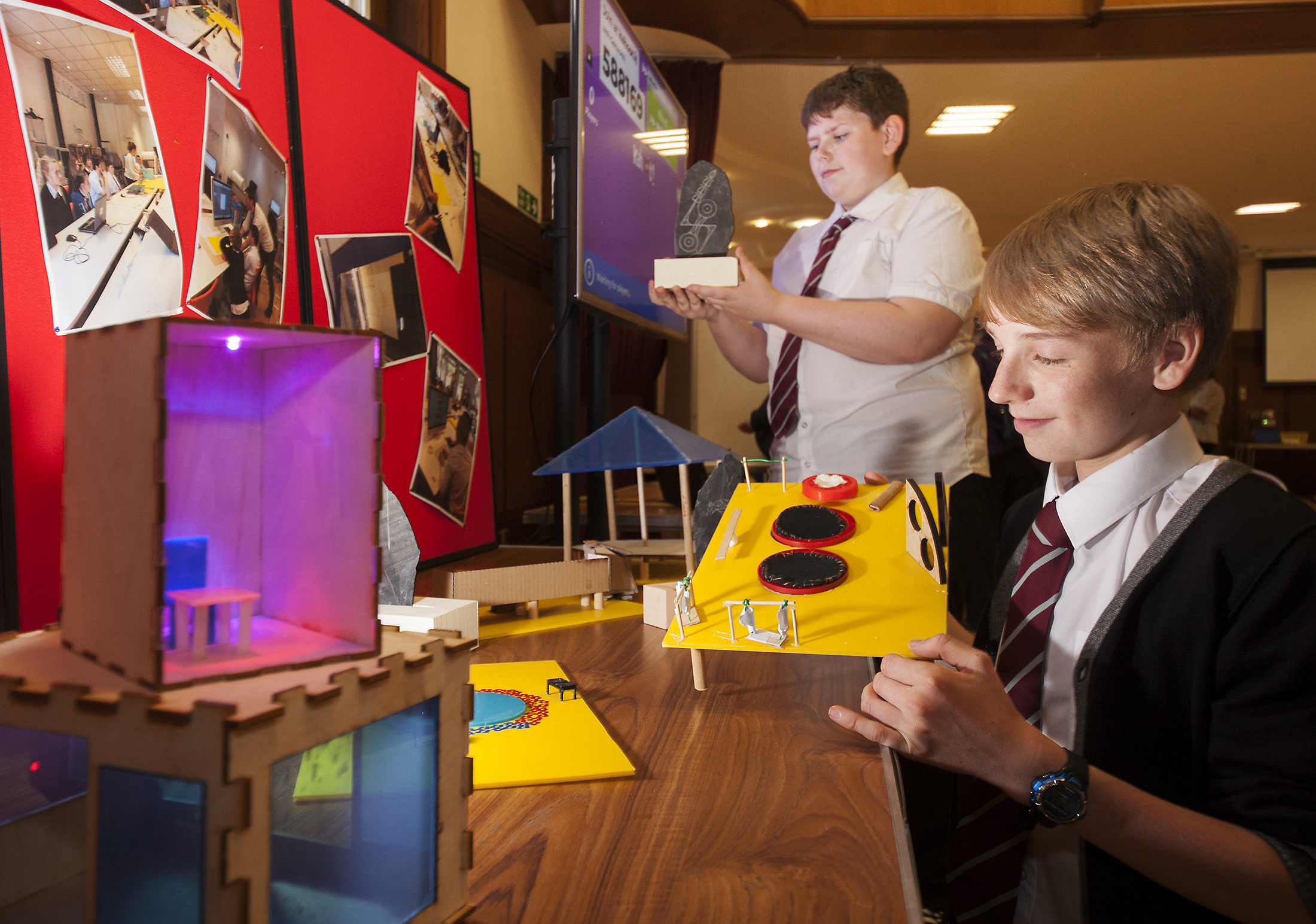 Forfar Academy S3 pupils Daniel Gough (left) and Robbie Stout with pupil models showing pupil designs for outdoor spaces.