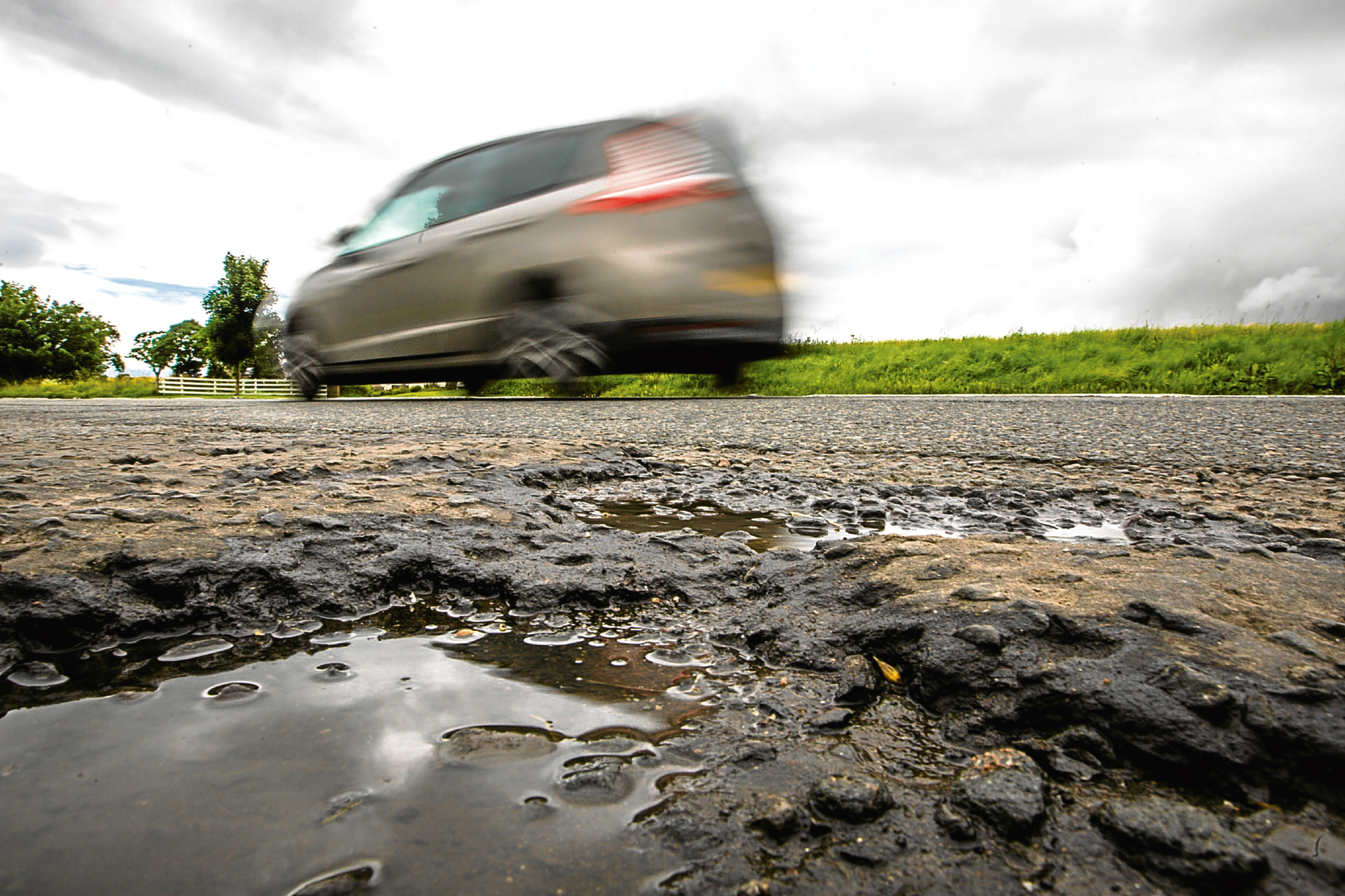Perthshire road surfaces in poor condition on the A94 North of Scone.