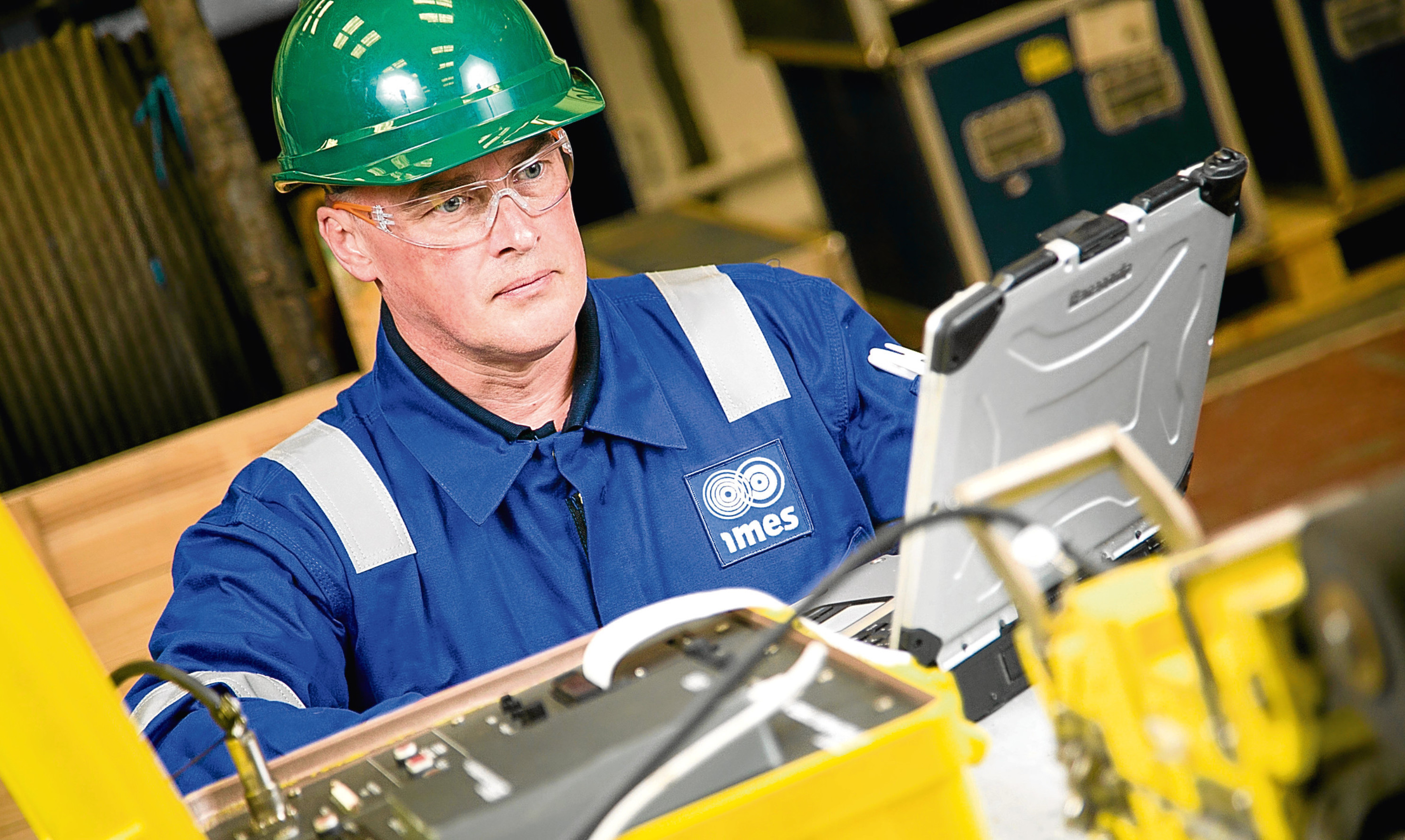A technician carries out an equipment inspection at IMES Rosyth