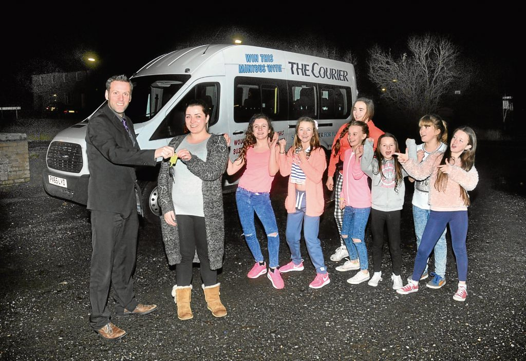 Courier assistant editor Dave Lord hands over the keys for the minibus to the RockSolid project.