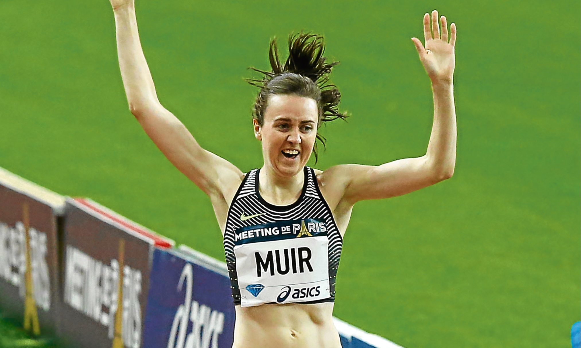 Laura Muir crosses the finish line to win the women's 1,500m event at the IAAF Diamond League athletics meeting at Stade de France stadium.
