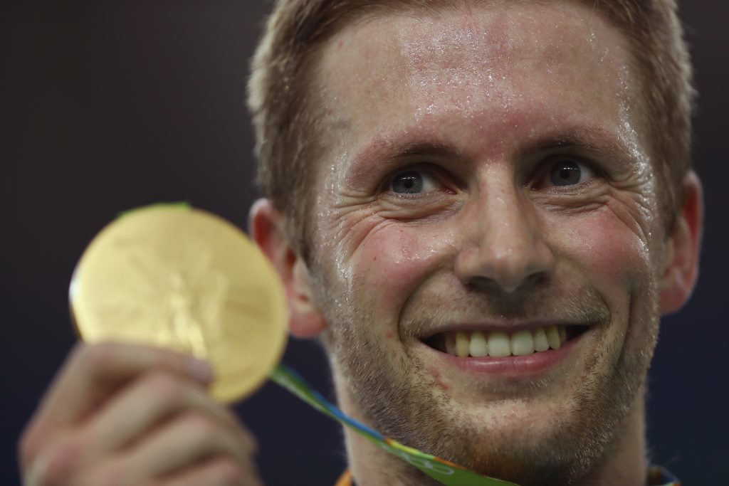 Jason Kenny with one of the British cycling team's many medals.