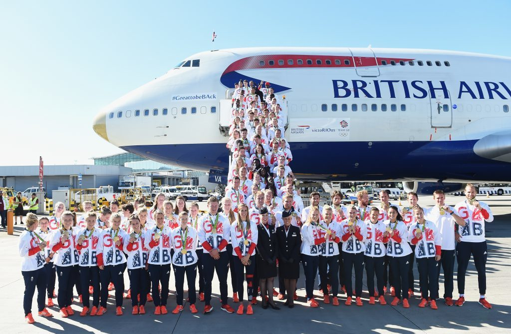 Team GB athletes pose after arriving home at Heathrow Airport on August 23, 2016 in London, England.