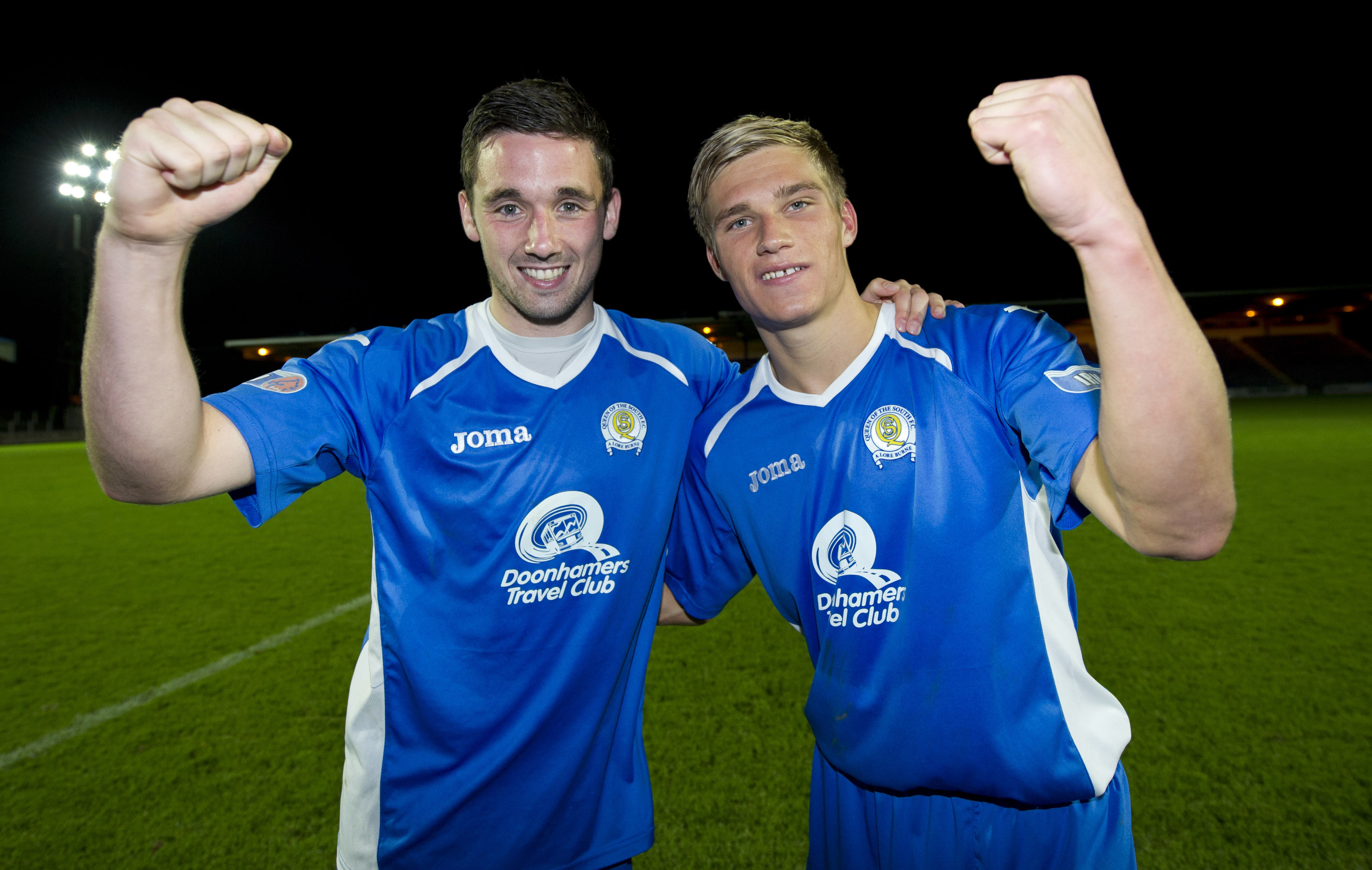 Nicky Clark and Gavin Reilly celebrate a win at Queen of the South.
