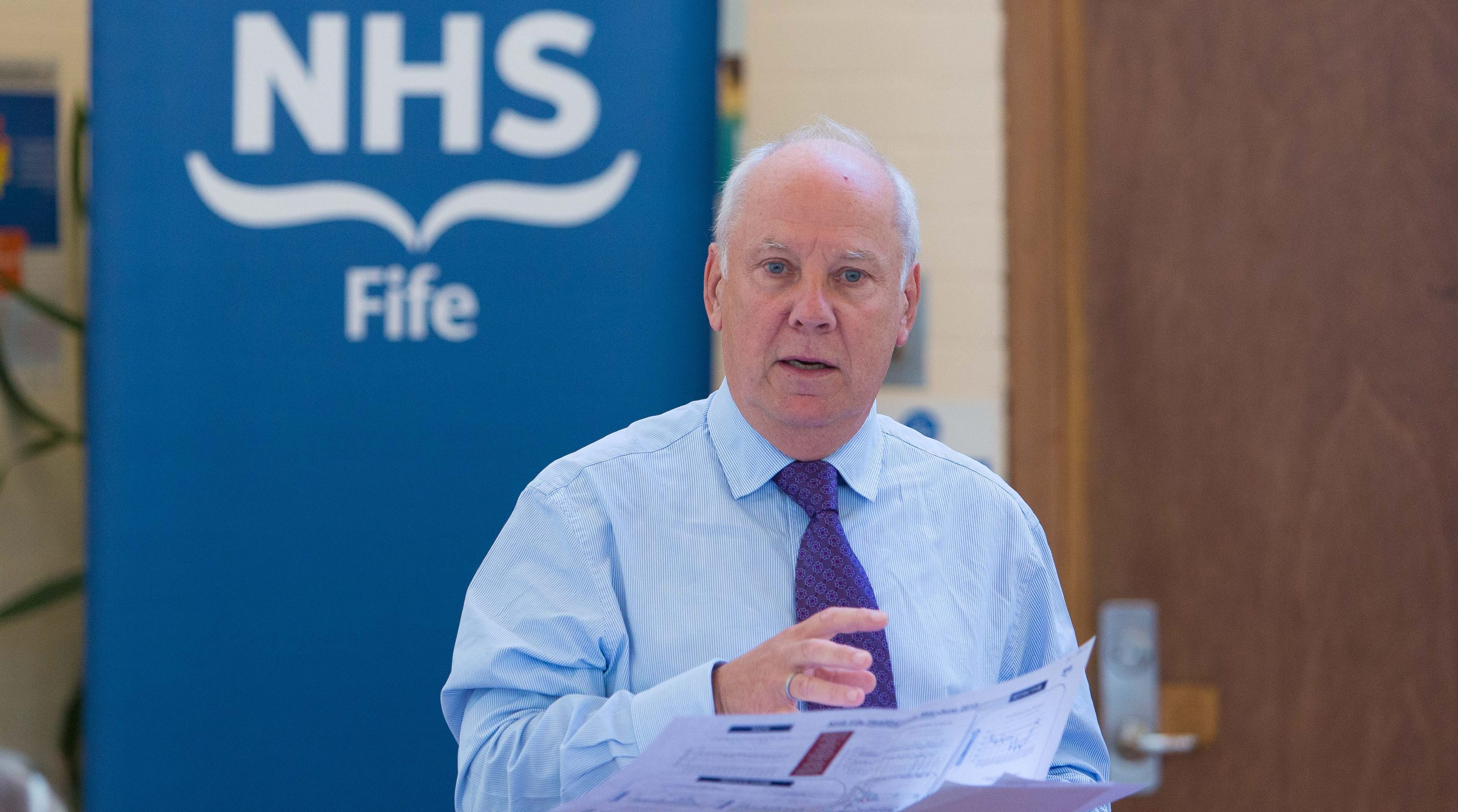 Chairman Allan Burns addresses a previous annual review.