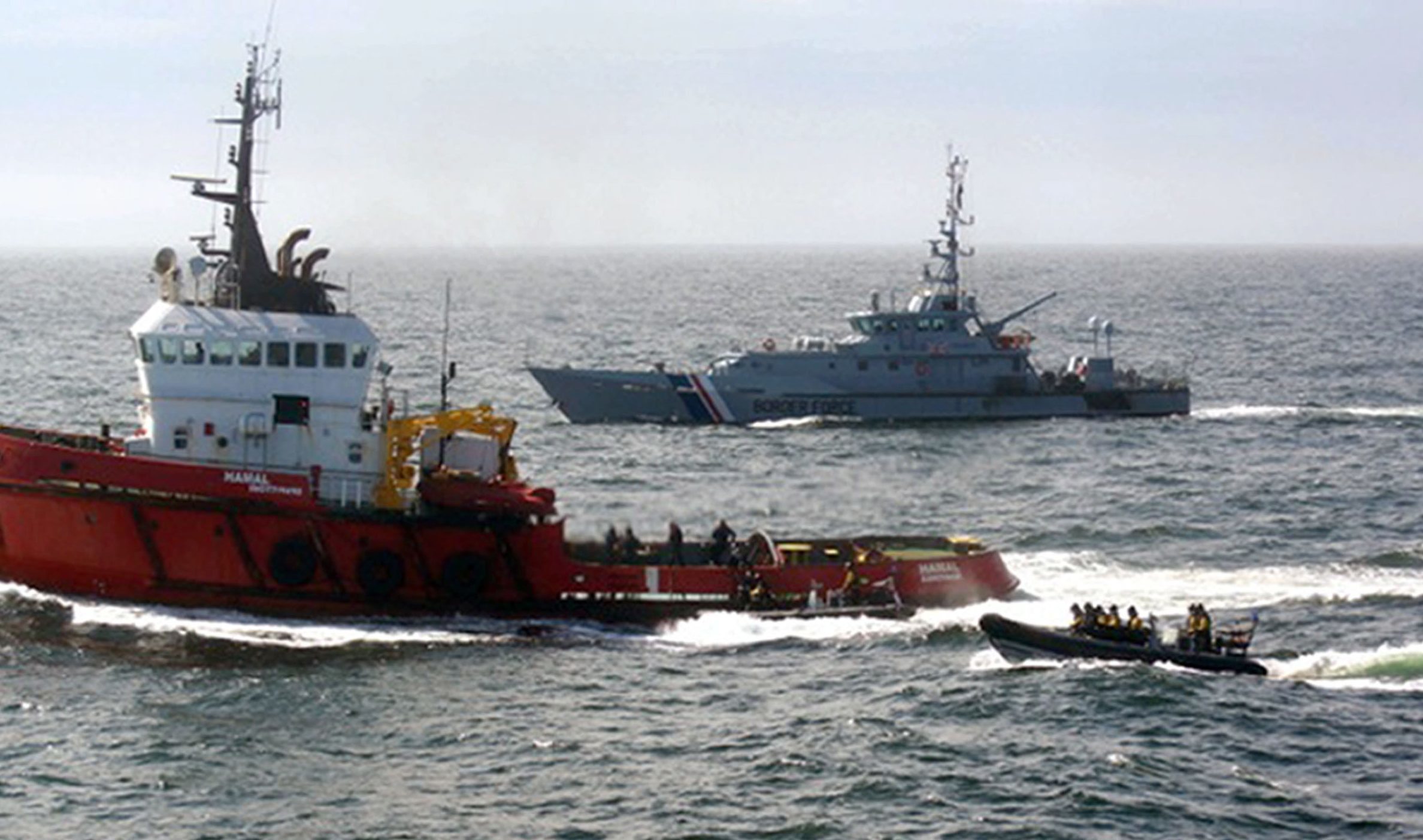 MV Hamal (left) as it was intercepted by the frigate HMS Somerset and Border Force cutter Valiant (right) about 100 miles east of the Aberdeen.