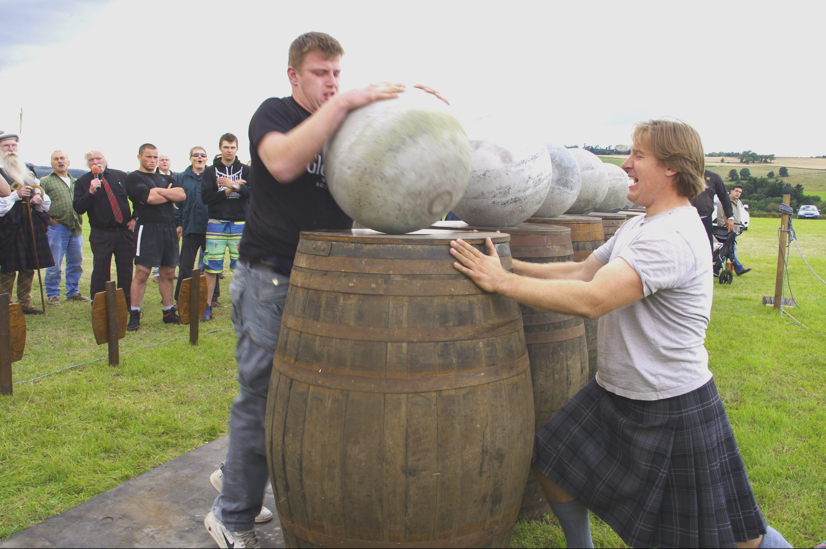 Lorne Colthart lifts the last Ardblair Stone while Charlie Blair Oliphant steadies the barrel at the Blairgowrie Highland Games.