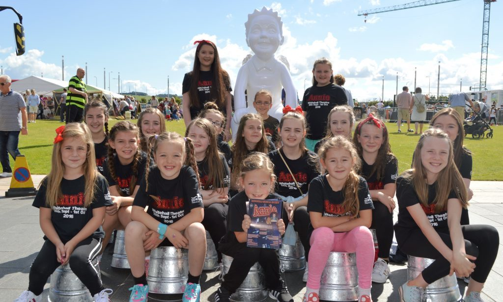 Youngsters with one of the Oor Wullie Bucket Trail statues at Slessor Gardens.