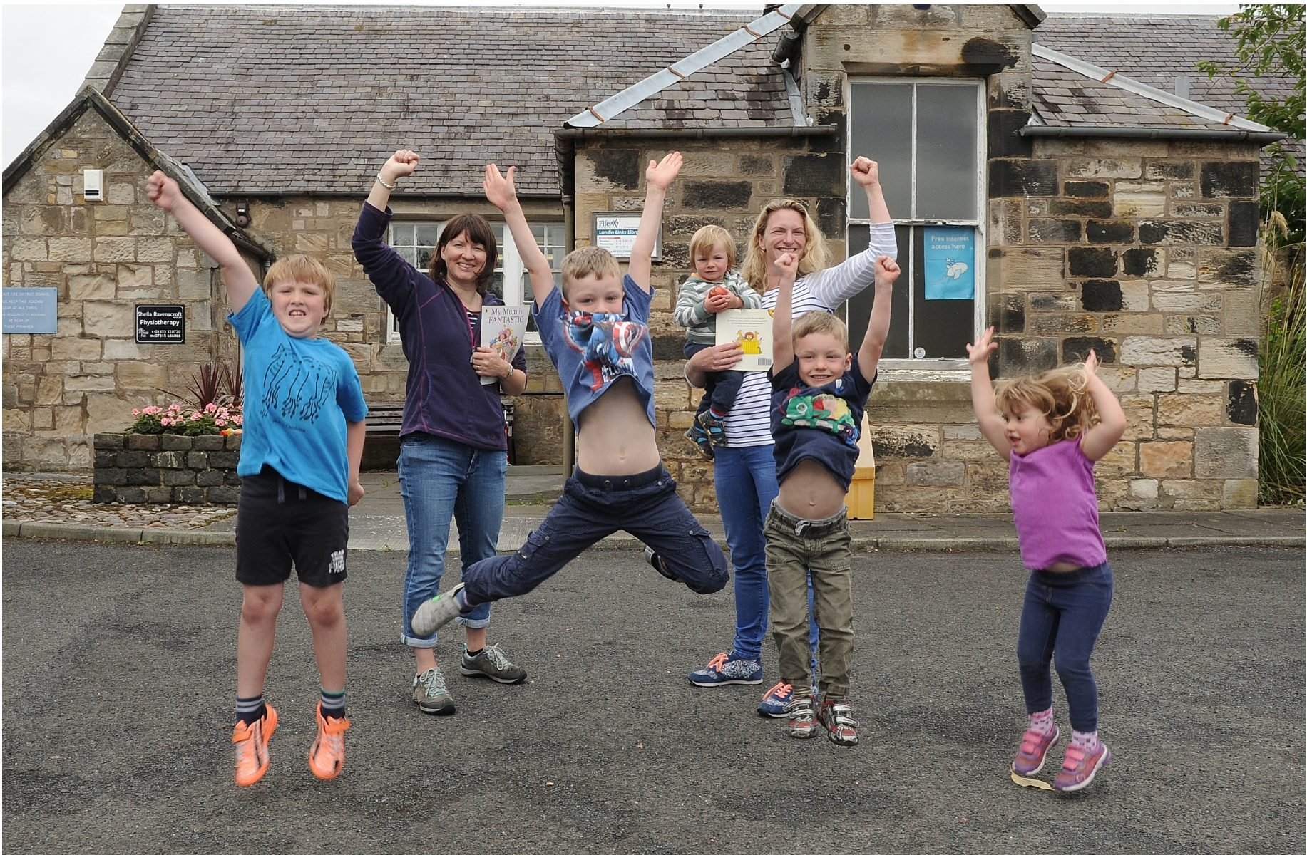 Celebrating at Lundin Links Library are children Murray, 7, Archie, 6, Innes, 4, and Emma, 3, with Heather Paterson and Emily Macdonald with Ruari, 1.