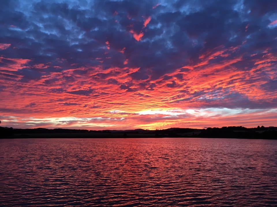 The spectacular sunset reflected on Fingask Loch, by Gavin Turnbull.