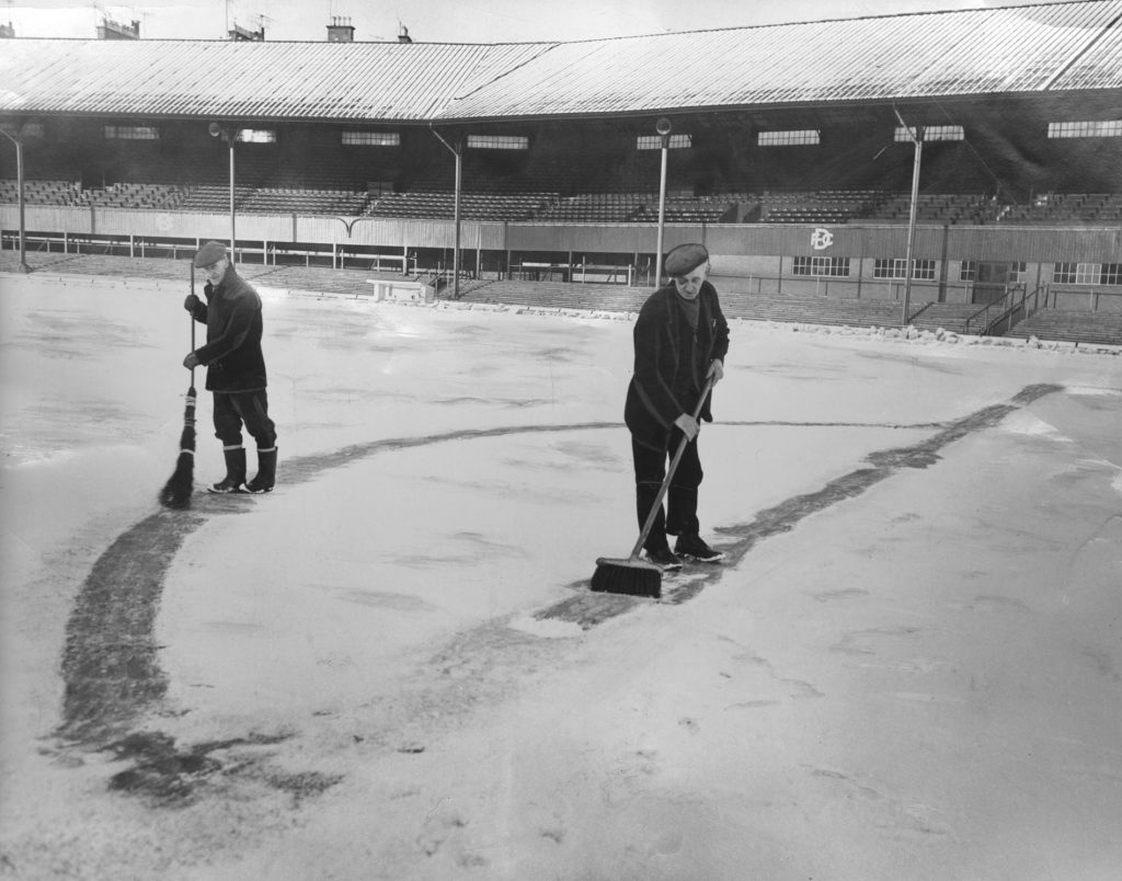 January 1963: The pitch is cleared of snow to allow a game to take place.