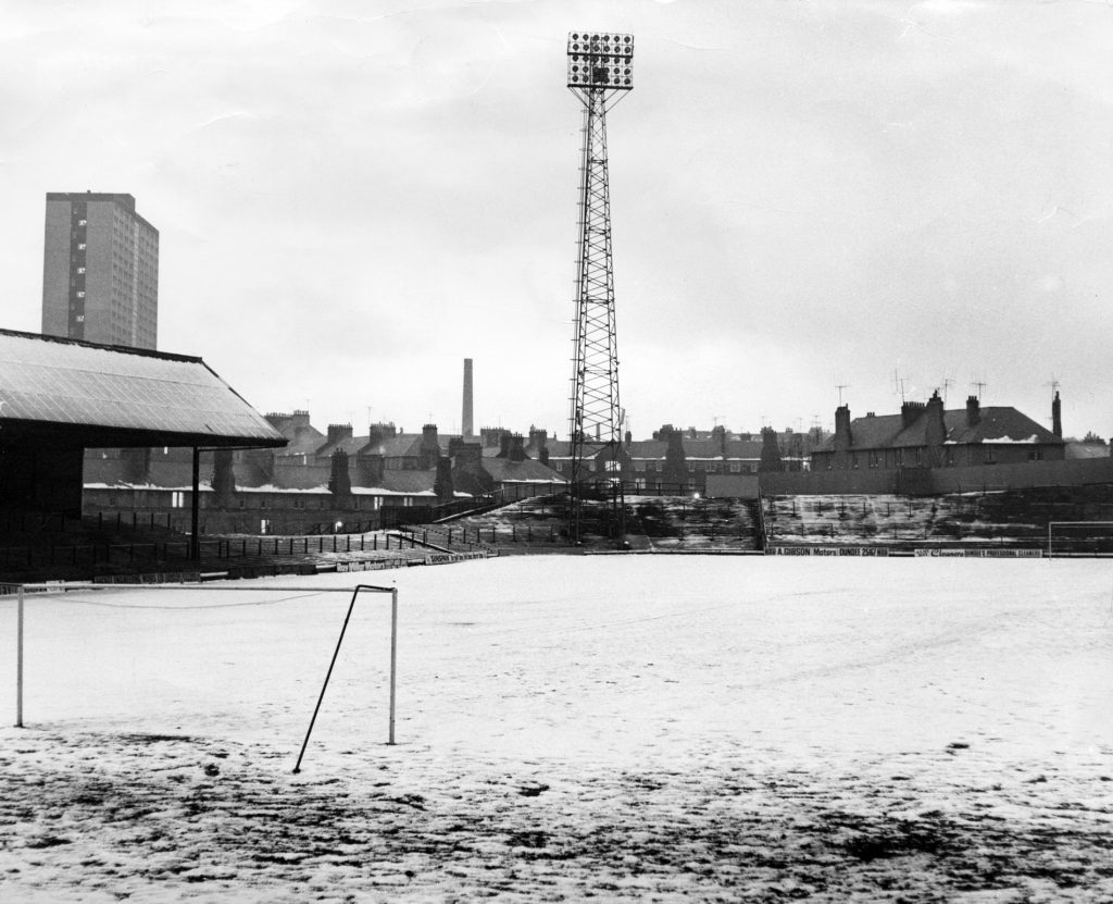 January 1972: Snow covers the pitch for a New Year's Day game.