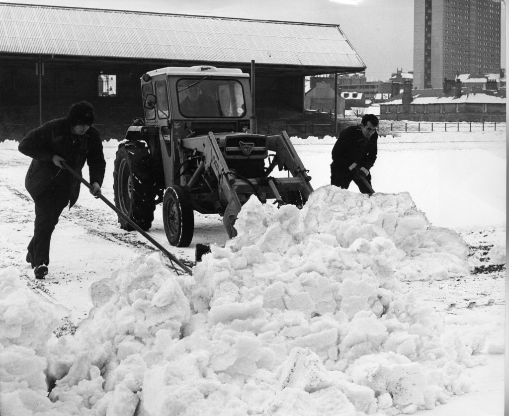 December 1974: Workmen clearing the snow for a game against Celtic.