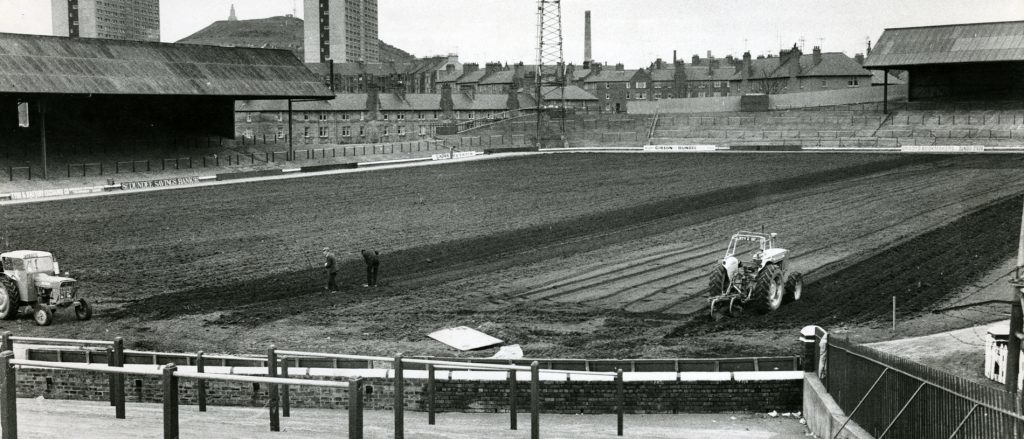 April 1975: The pitch being dug to allow work on a new drainage system.
