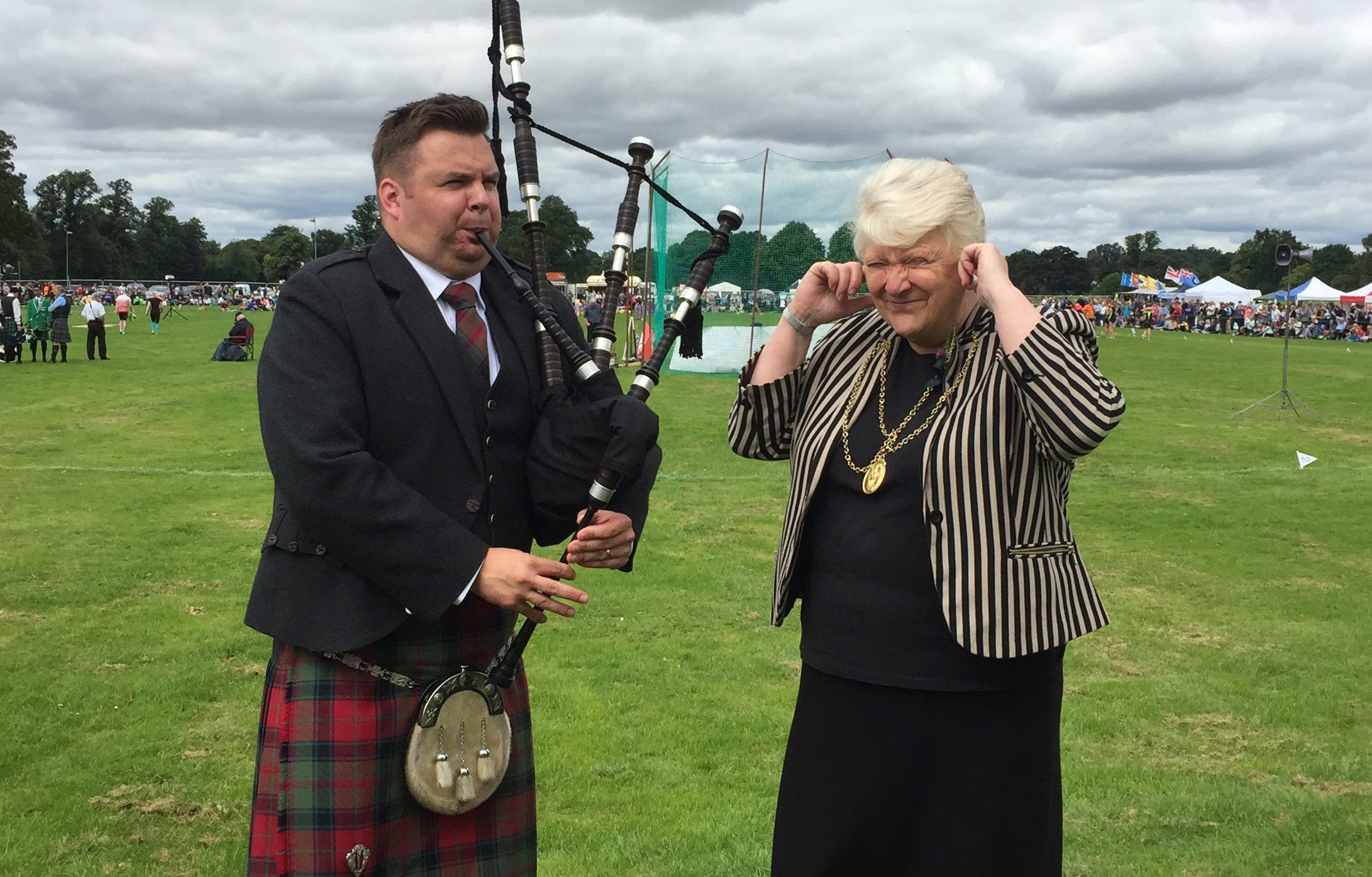 Stuart Cassells plays the pipes for Liz Grant.