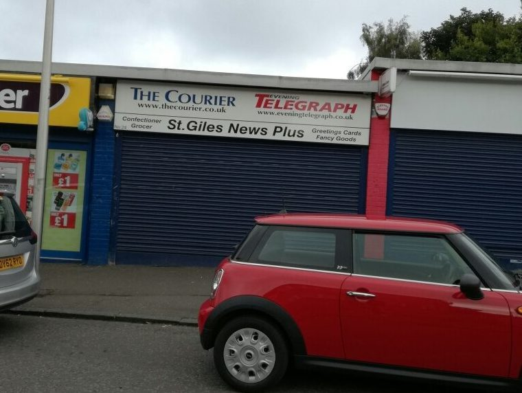 Police are on the hunt for a man suspected of trying to rob the St Giles News Plus store