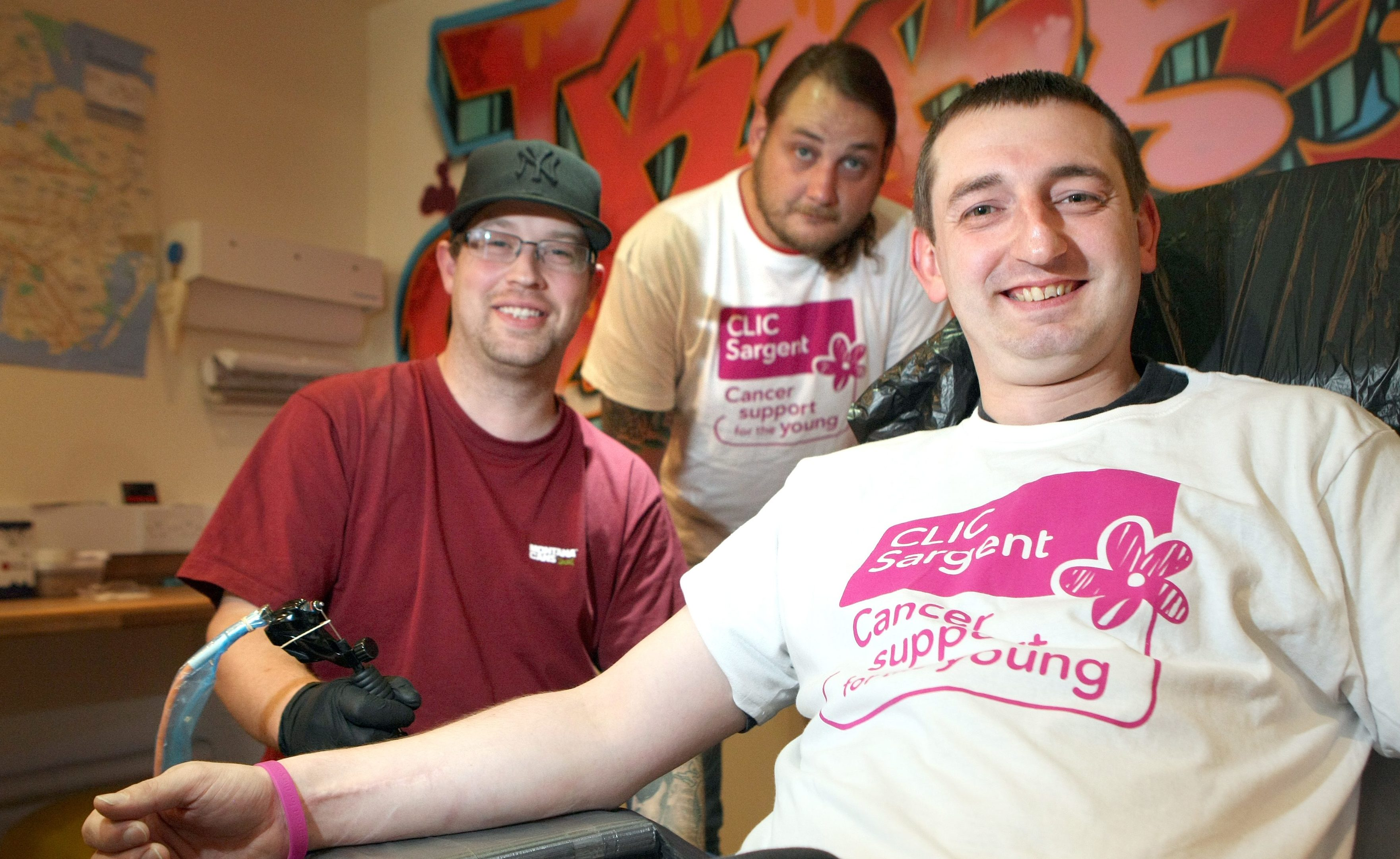 Peter and Stewart with Adam Milroy of Tribal Skribe in Lochee where the tattoos will be done later this month.