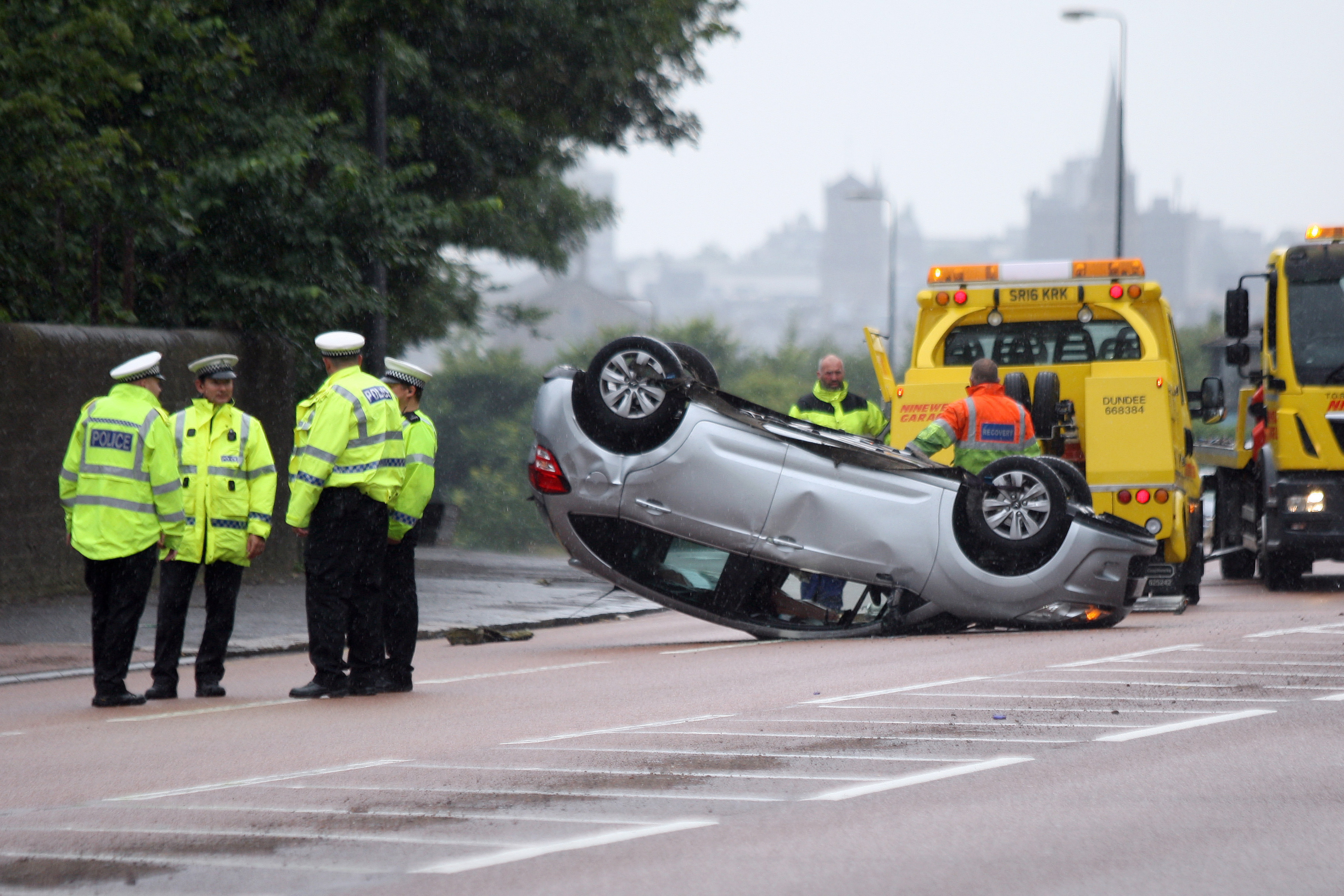 The overturned car.