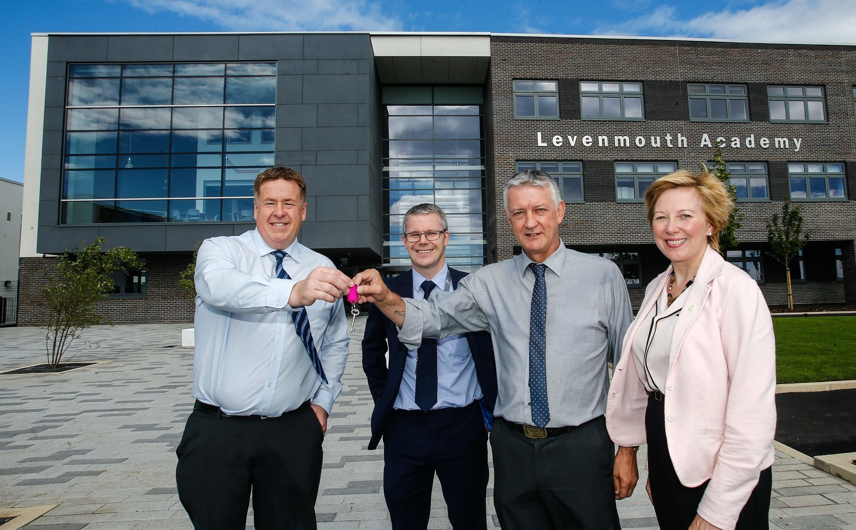 Martin Cooper, of BAM Construction, hands over the keys to Levenmouth Academy to Cllr Tom Adams, chair of the council's Levenmouth area committee and council depute leader Cllr Lesley Laird