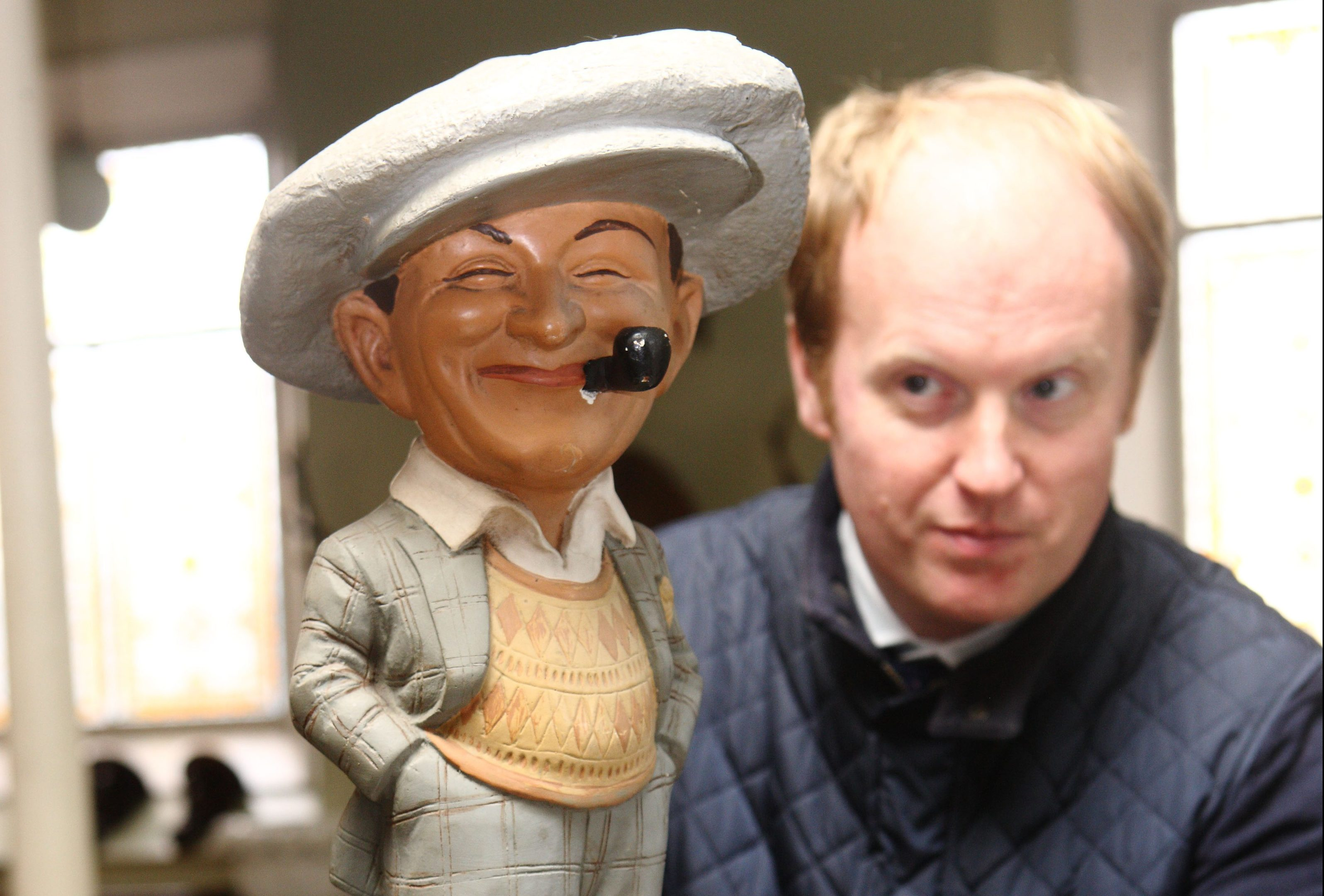 Nick Burns with an early 20th century  shop figure figurine.