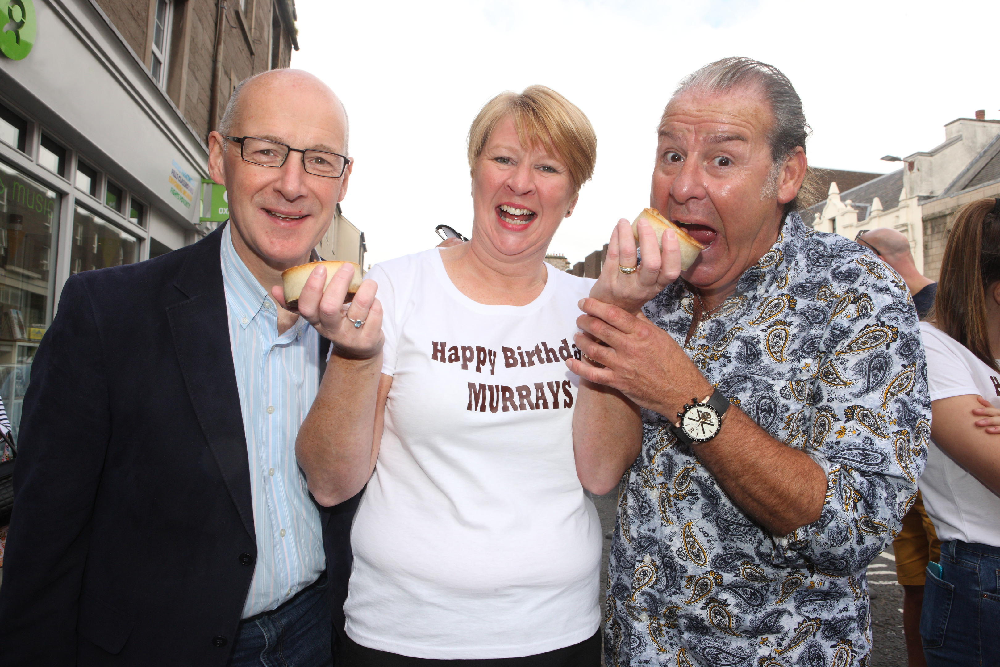 John Swinney and actor Andy Gray help celebrate 115 years of Murrays the Bakers in Perth, with owner Linda Hill.