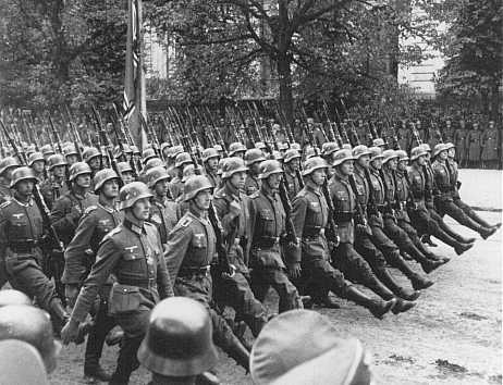 The Nazis parade through Warsaw following the invasion of Poland in September 1939.