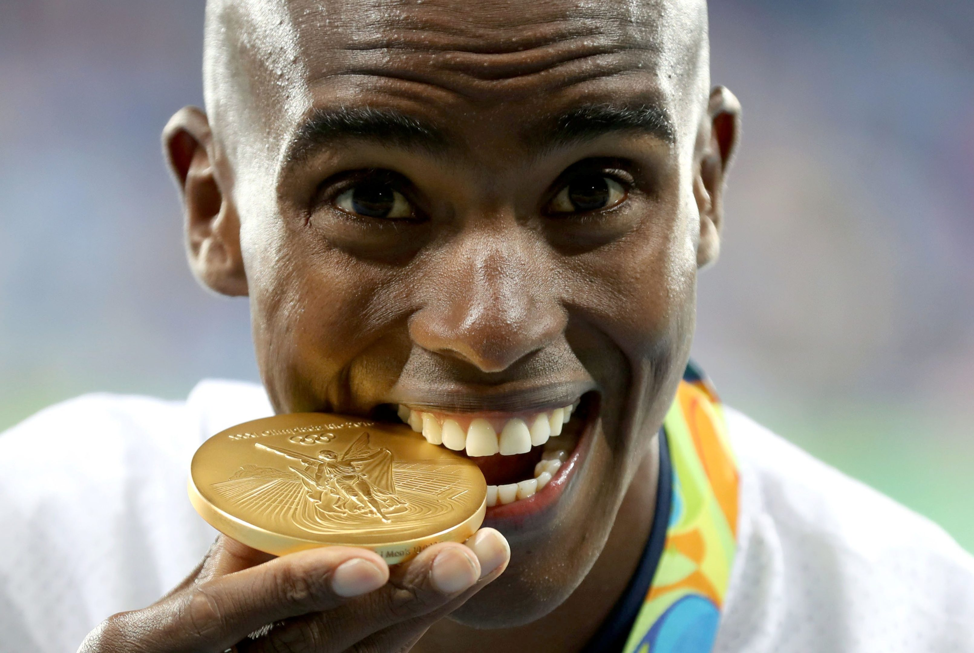 Team GB's Mo Farah with his gold medal.