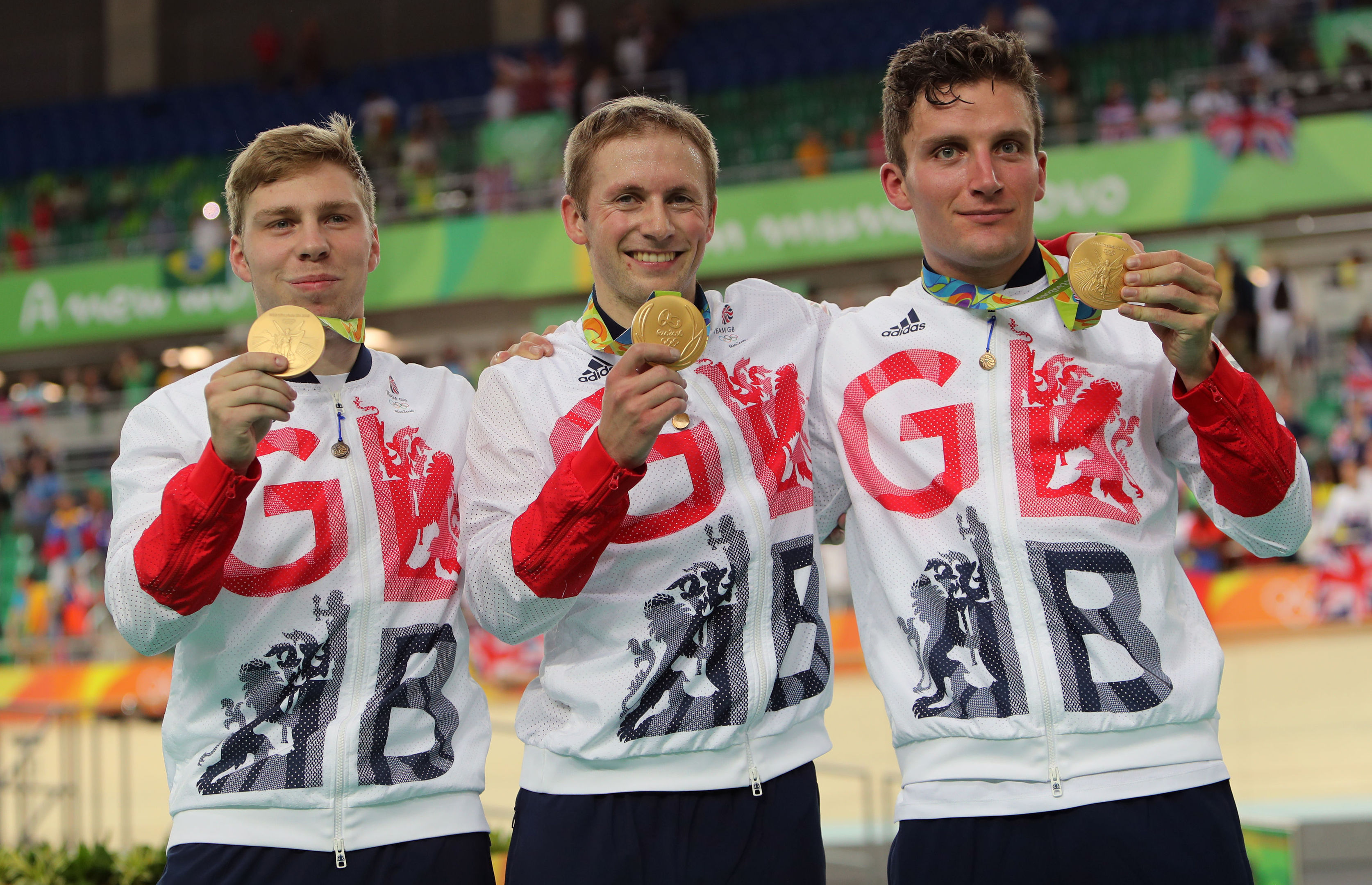 Great Britain's Philip Hindes, Jason Kenny and Callum Skinner with their gold medals following the men's team sprint final.