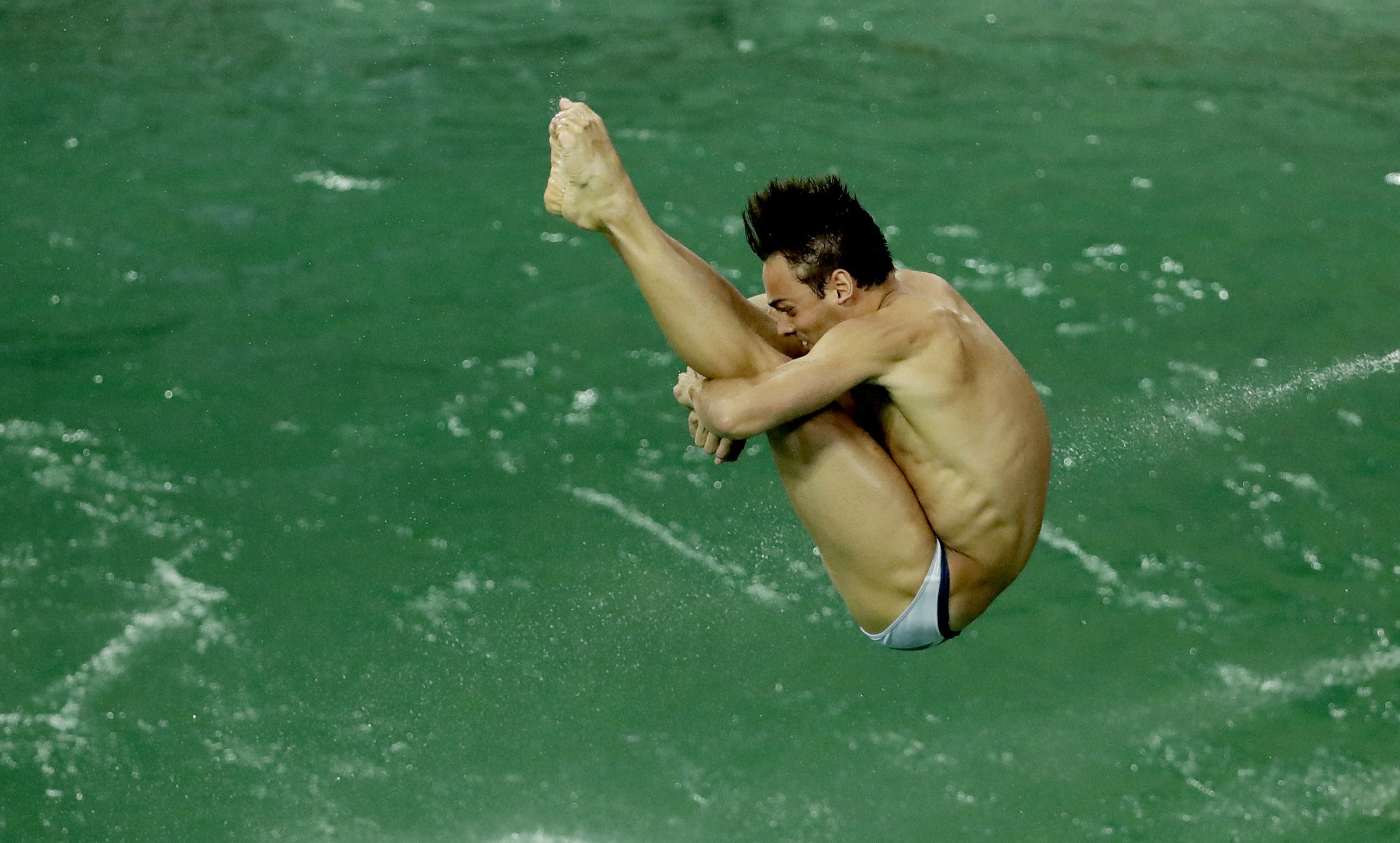 British diver Tom Daley takes part in a training session after the water in the diving pool turned green.