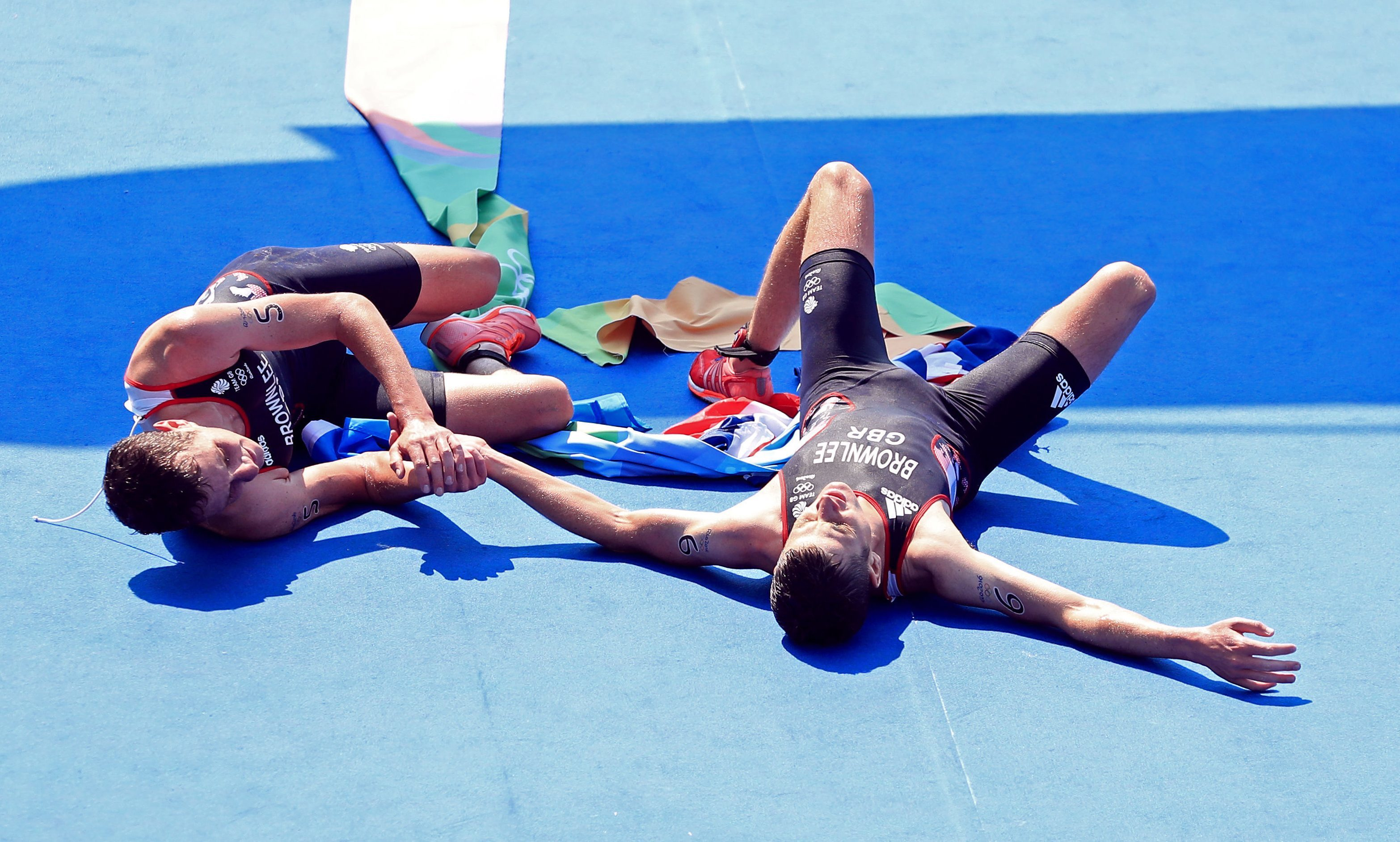 Alistair Brownlee (left) and brother Jonny embrace after winning gold and silver in the men's triathlon.