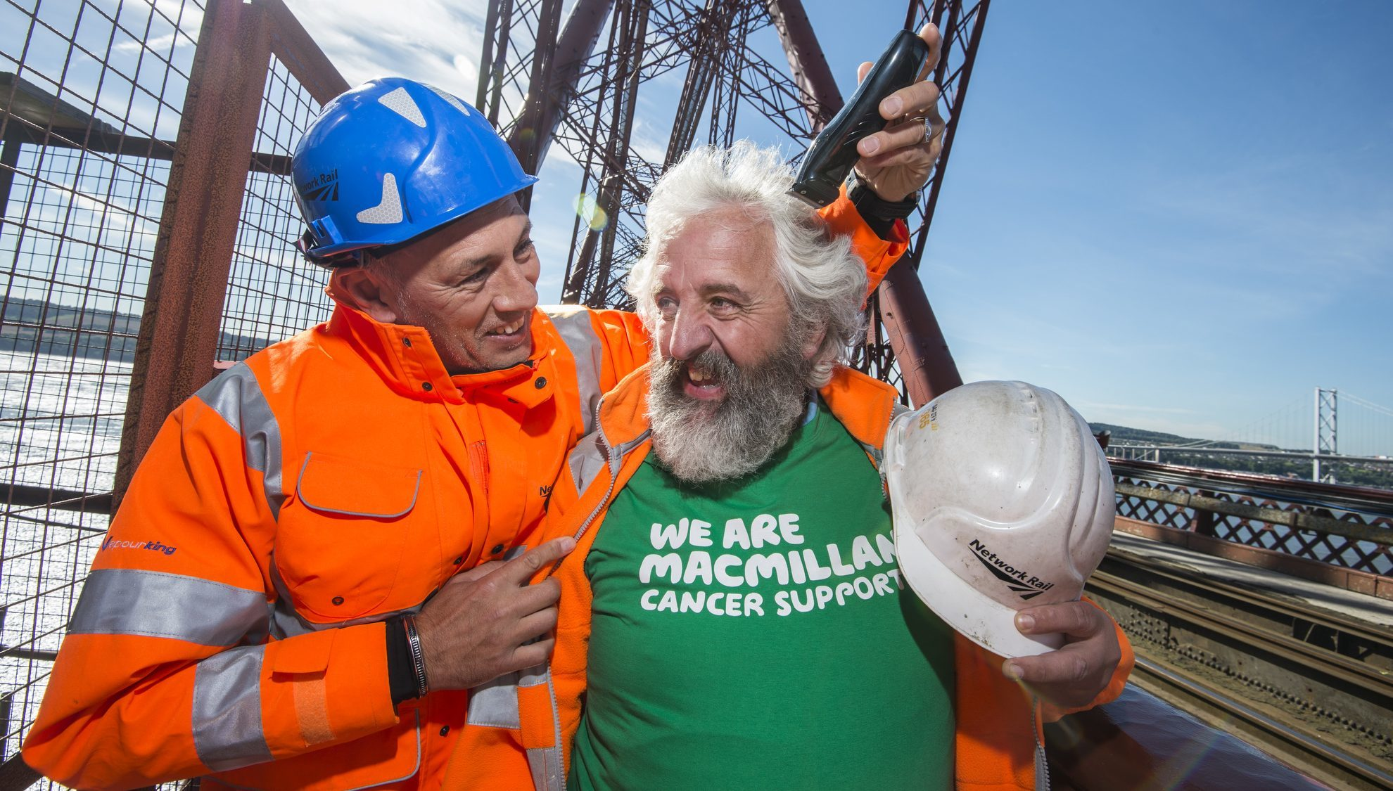 Network Rail employee Davie O'Donnell had a close shave with Rangers legend Mark Hateley on top of the Forth Rail Bridge.
