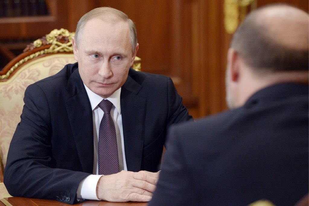 Russia's President Vladimir Putin (L) and Arkhangelsk Region Governor Igor Orlov during a meeting at Moscow's Kremlin.