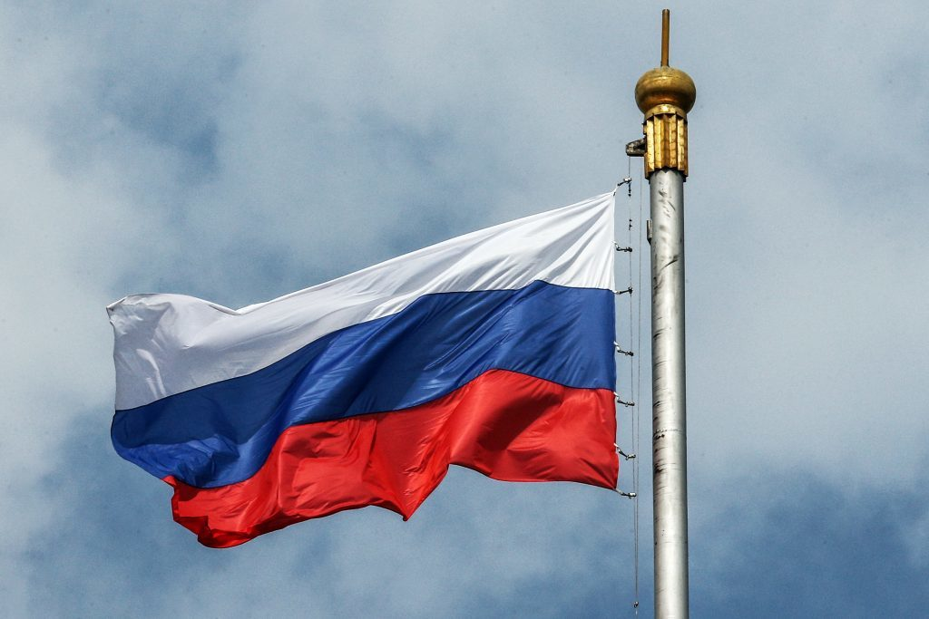 A Russian flag waving on the wind on the House of the Russian Government.