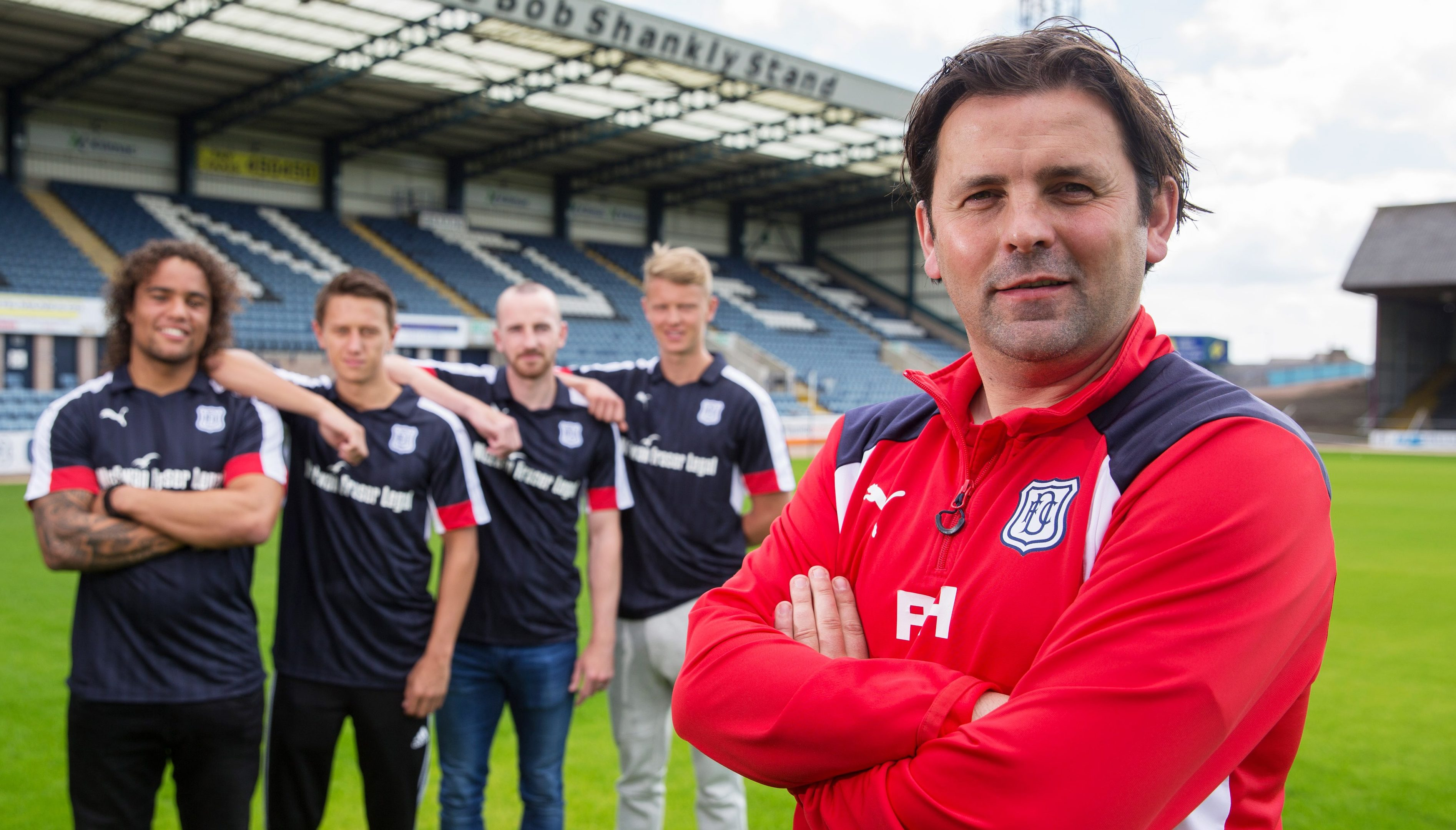 Dundee manager Paul Hartley with new signings (L-R) Yordi Teljsse, Danny Williams, James Vincent and Mark O'Hara.