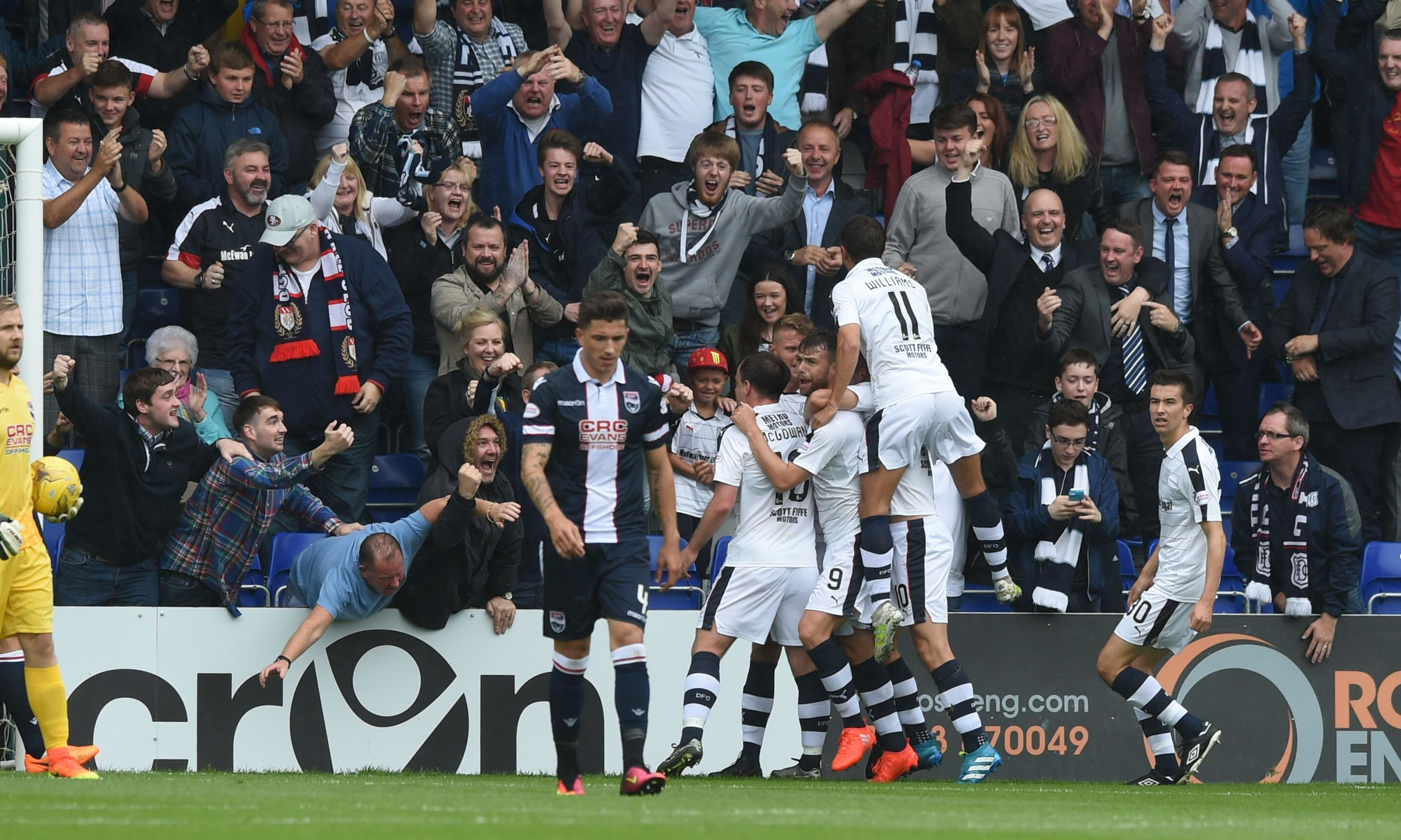 The Dundee players celebrate the Rory Loy opener.