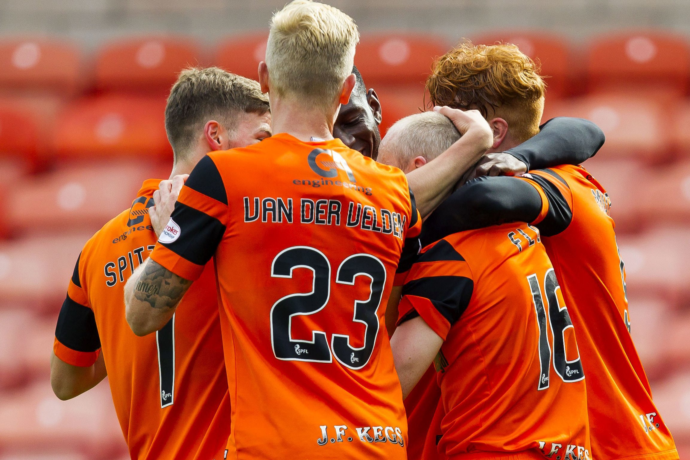 The United players celebrate after Willo Flood scored their third goal.