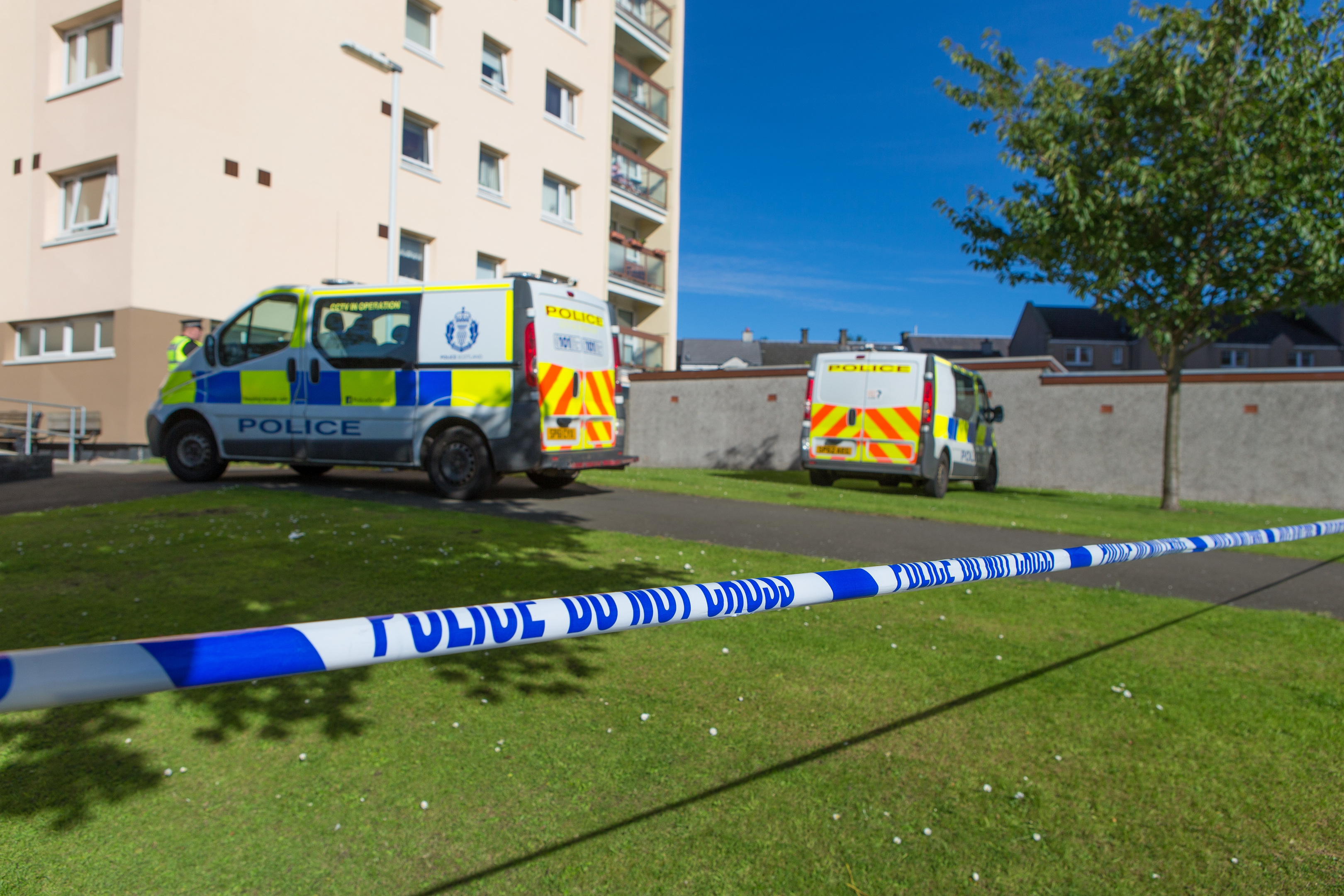 Police at the scene outside Ravens Craig flats.