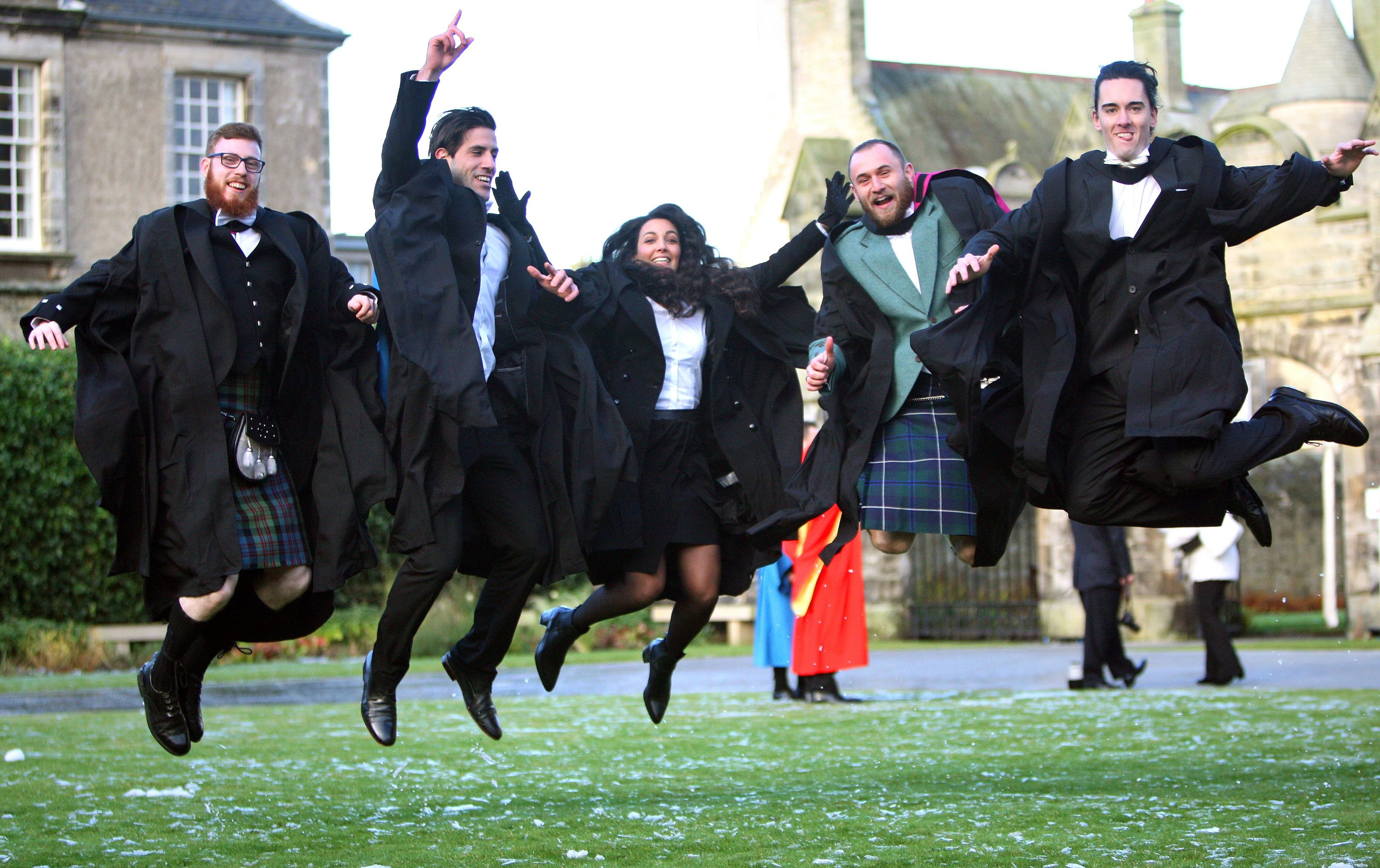 St Andrews students jumping for joy after graduating.