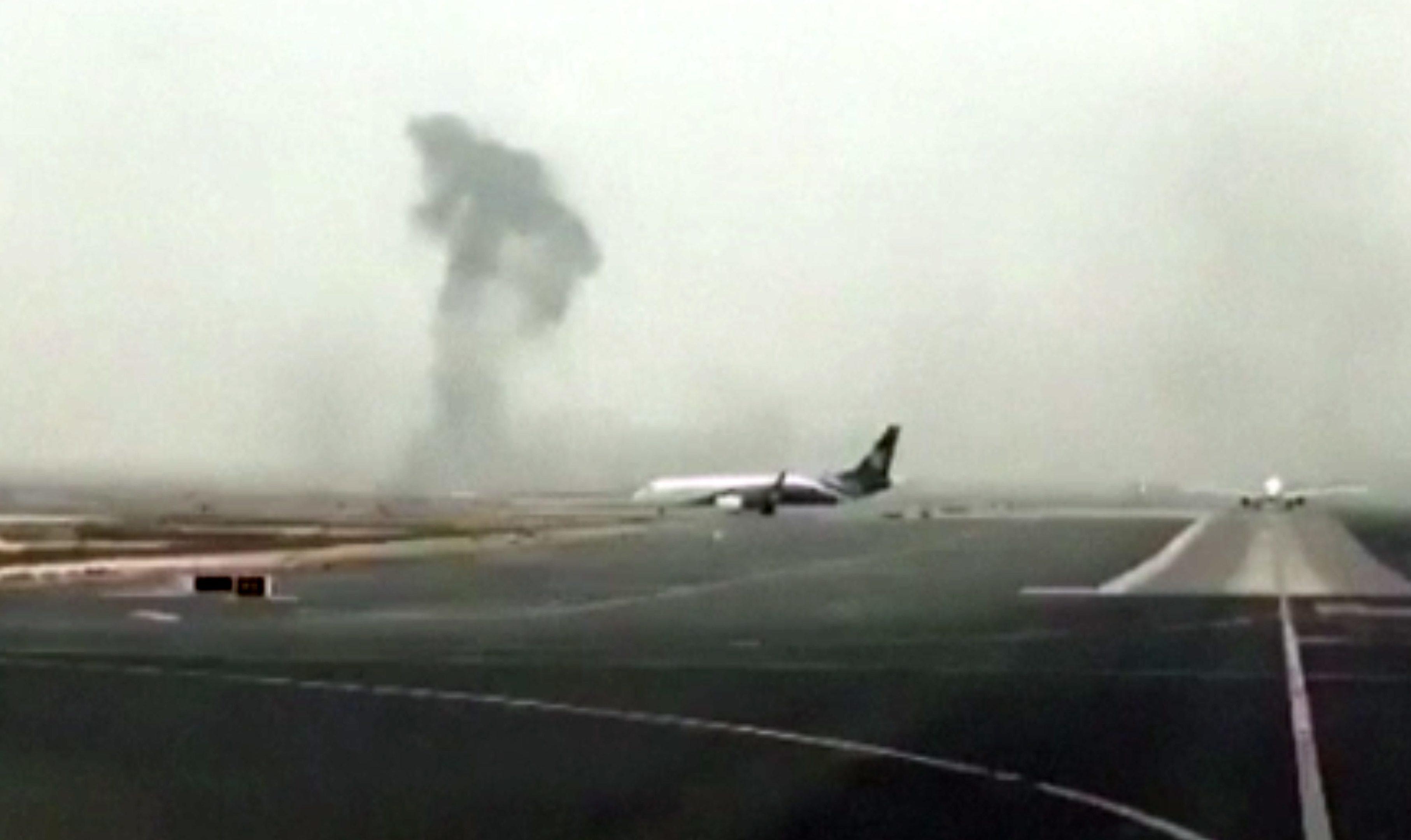 Smoke rising after an Emirates flight crash landed at Dubai International Airport.