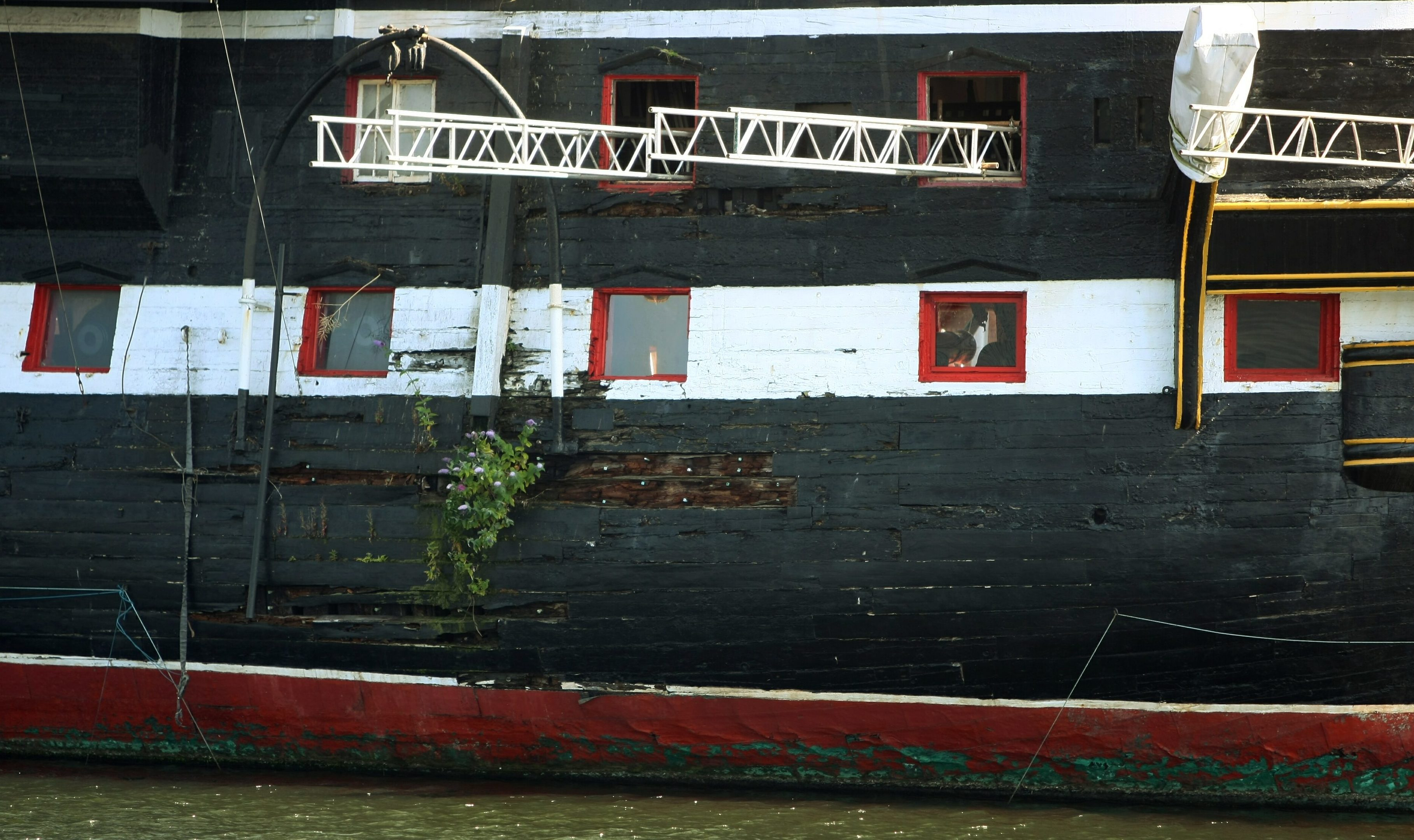 The side of the ship has suffered some weather damage.
