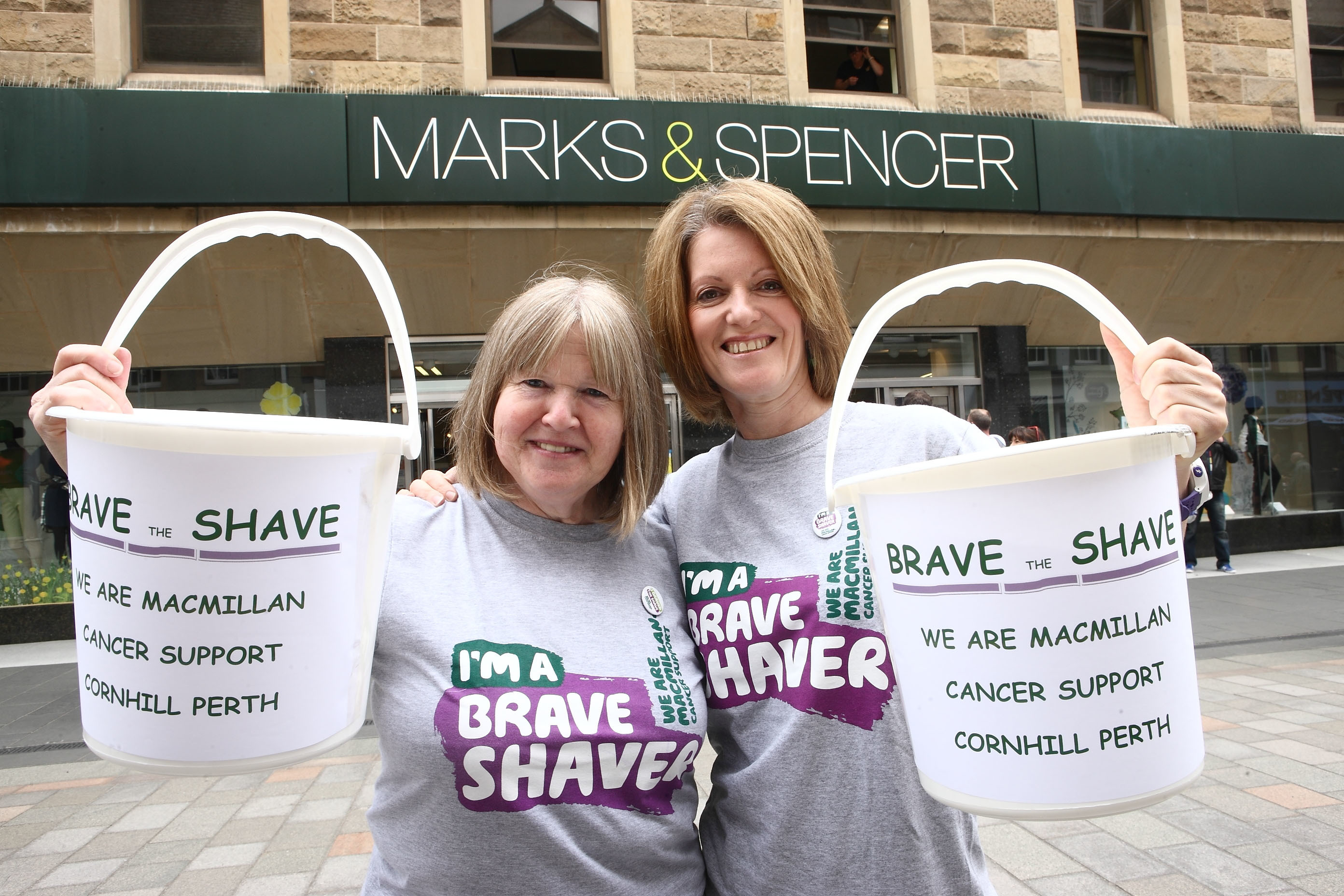 Edith Hannah (L) and Lorraine Scott help collect in Perth High Street  before they have their haircuts.