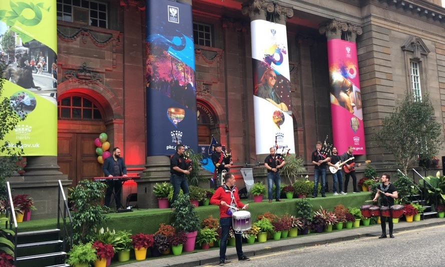 The Red Hot Chilli Pipers performing outside the City Hall at the City of Culture bid launch.
