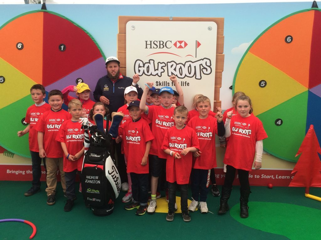 English pro Andrew Johnston with children at the R&A's SwingZone during the 2016 Open Championship at Royal Troon