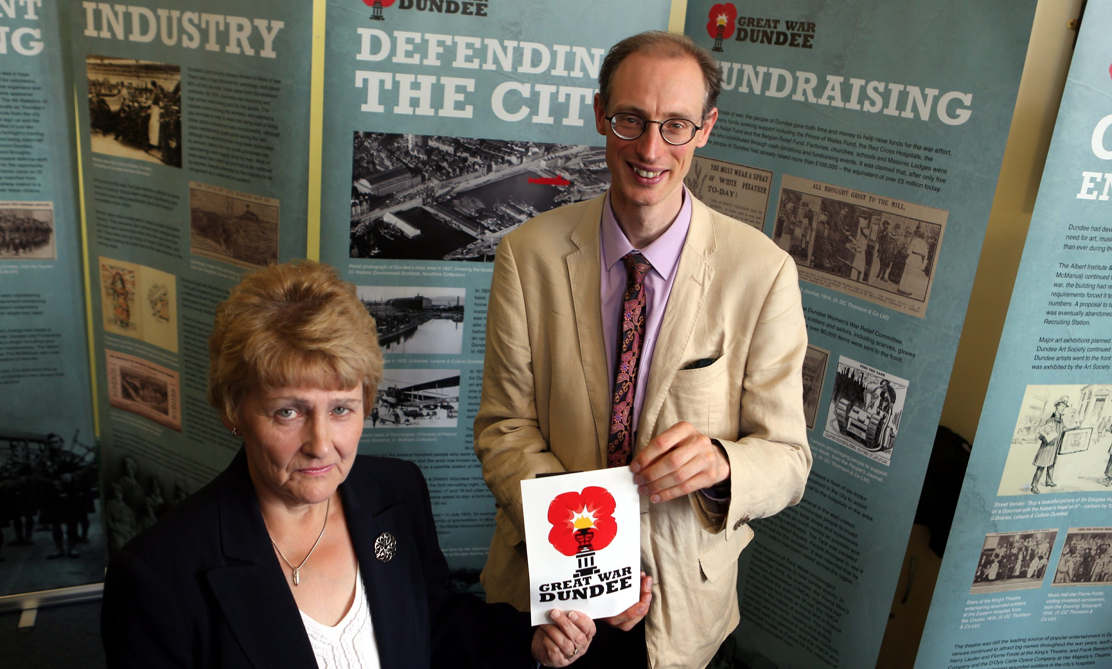 City archives volunteer Linda Nicoll and curator Matthew Jarron.