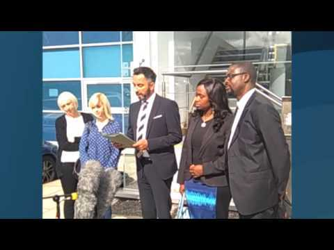 Lawyer Aamer Anwar with members of Sheku Bayoh's family