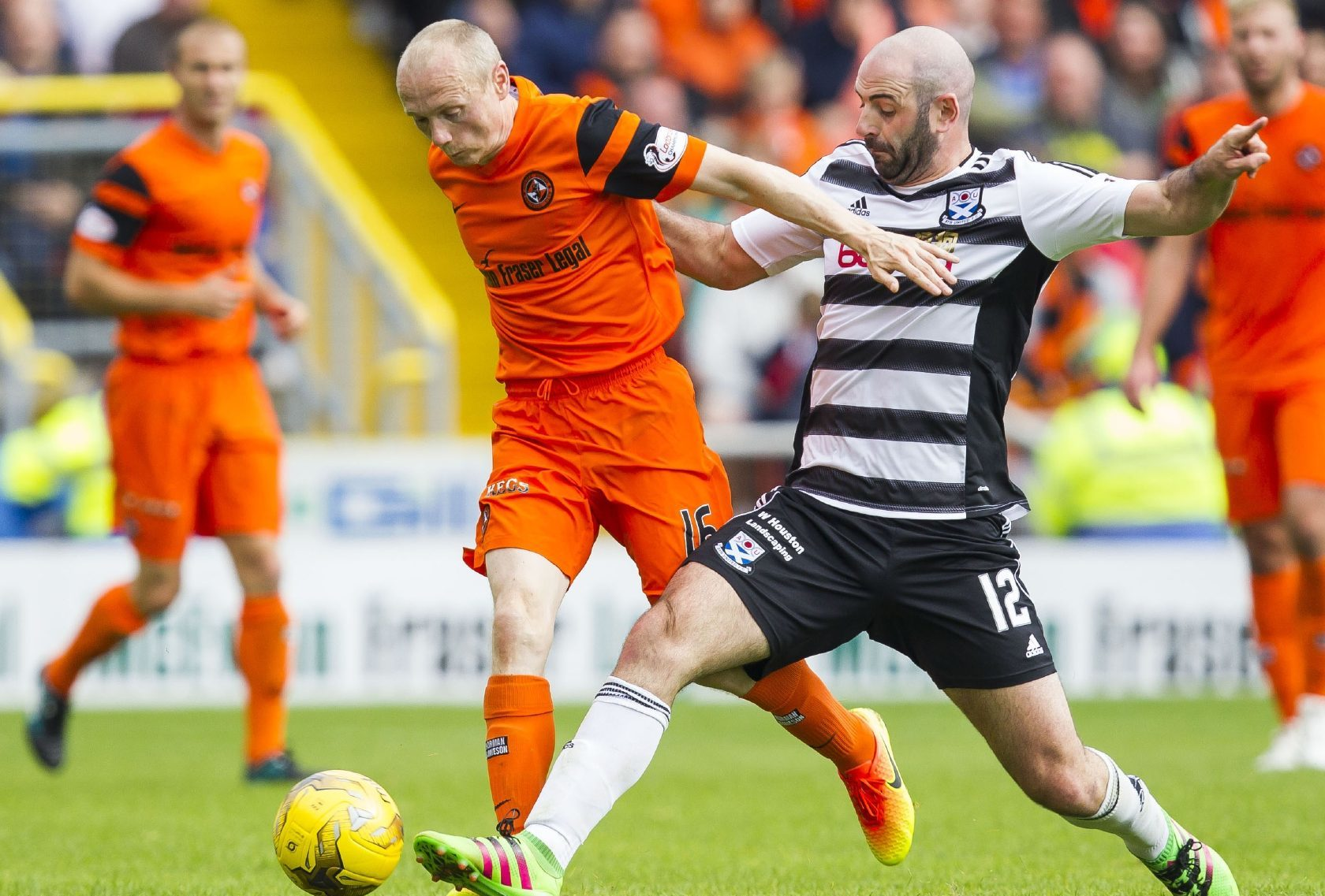 Willo Flood fends off a challenge from Ayr player Gary Harkins.